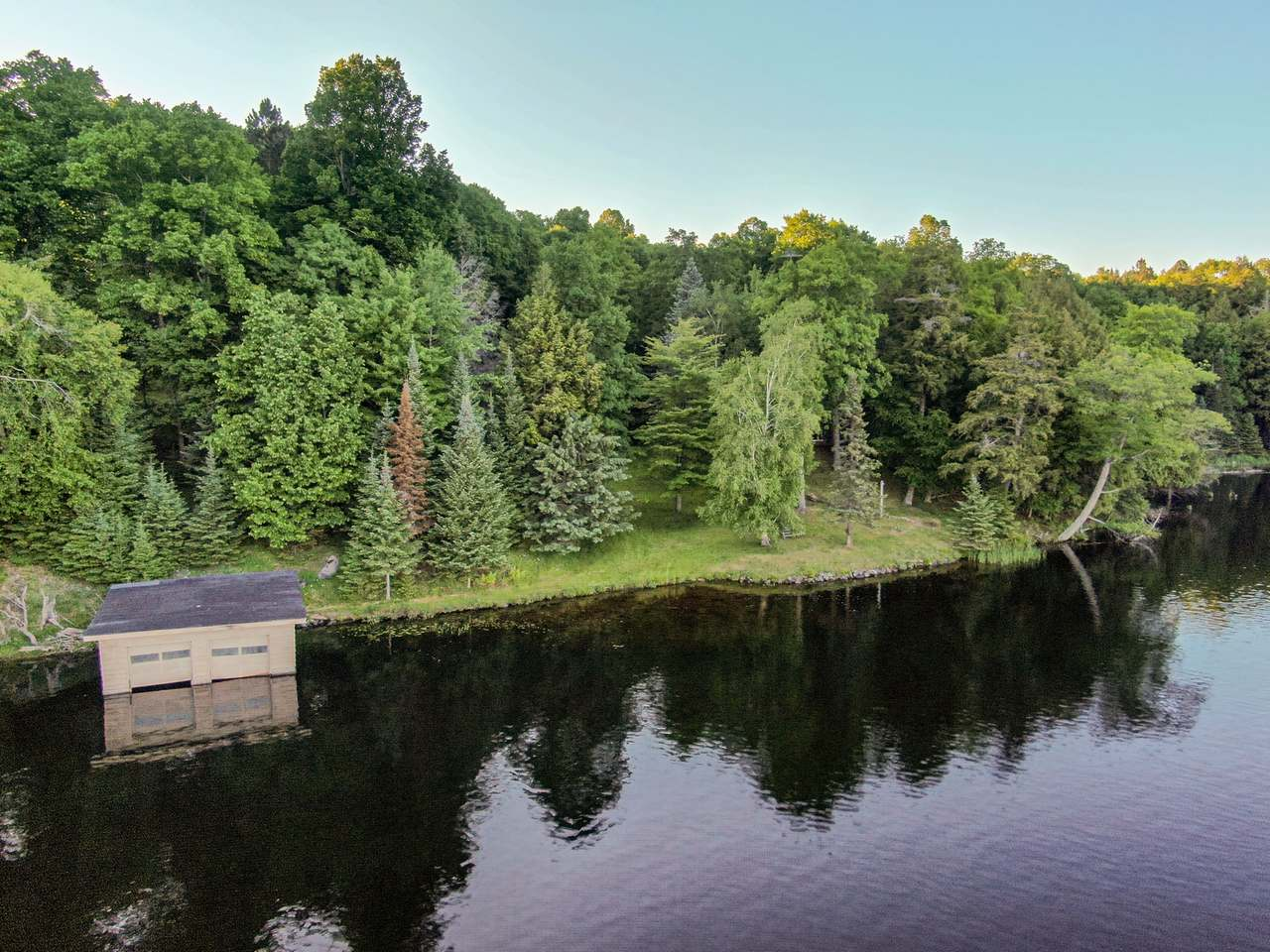 Looking for that special place to build your Northwoods retreat? You have found it on the Cisco Chain of Lakes! The parcel sits on the jewel of the Cisco Chain, Thousand Island Lake. It offers 650' of frontage and 4 acres of land. There is also a wet boathouse on the property. The property faces south for all day sun. The beach is sandy and offers great swimming. The fishing is outstanding too! The parcel is located 20 miles northwest of Land O' Lakes, Wisconsin. It is a perfect spot to build that Northwoods dream home.