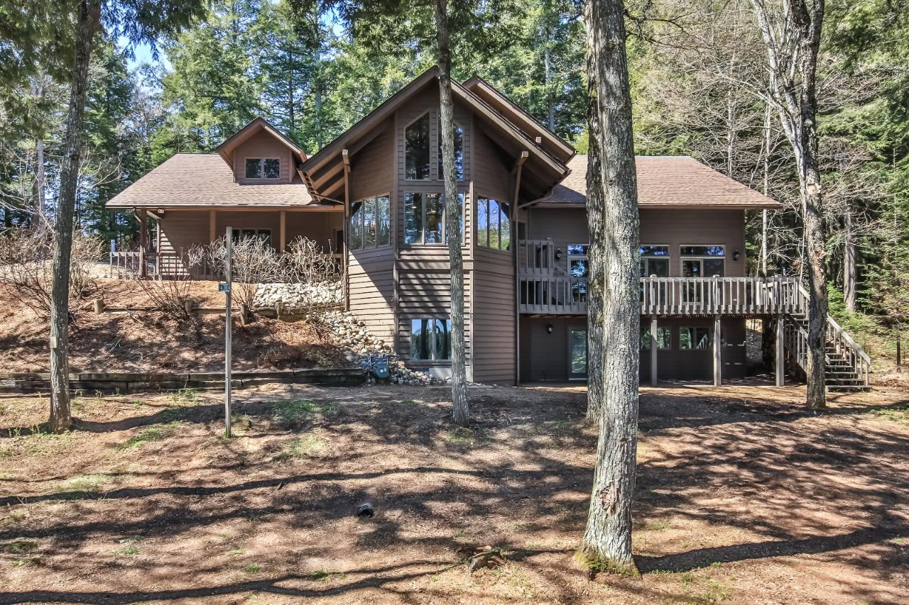 Beautiful, custom, remodeled home on one of Vilas County's most premier lakes. This 4 bedroom, 4 bath home is situated on 2.6 acres on Forest Lake. The home features endless water views with a lakeside wall of glass. The large family room offers cathedral ceilings and beautiful floor to ceiling fieldstone fire place. The master suite with a walk-in closet and a bathroom large enough to do a cartwheel in offers its own screened in porch. Enjoy the lake and entertaining on the lake side deck stretching over 36 ft. The top of the line kitchen is surround with glass and water views. Main floor laundry, a 3 car attached garage and a black top driveway complete all the amenities one could ask for. This type of character, quality and location is a rare find.
