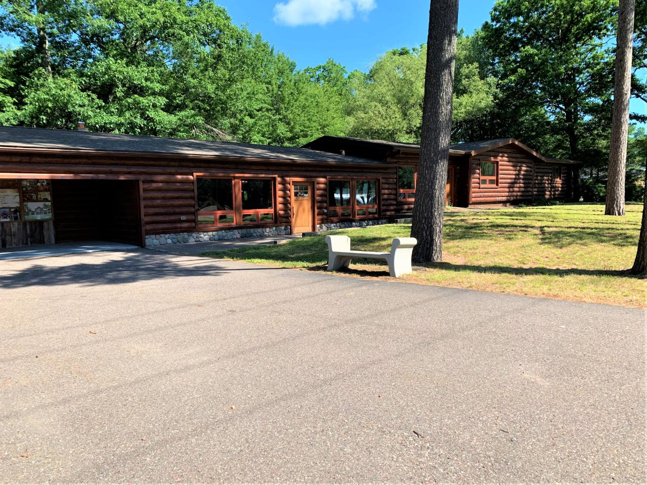 Primer commercial building and location. Well maintained commercial building with excellent curb appeal. This building offers over 5,000sqft to utilize. The outside is complete with log siding, landscaped and easy access with sidewalks. The large showroom is 38 X 30 with an additional 24 X 20 show room, complete with vaulted ceilings. Multiple large offices throughout and an unfinished walkout basement with a full kitchen. 42 X 14 attached garage area and 20 X 20 storage attached to the garage and large showroom. With easy access and over 200 ft of frontage on US Hwy 51 this property has endless options.
