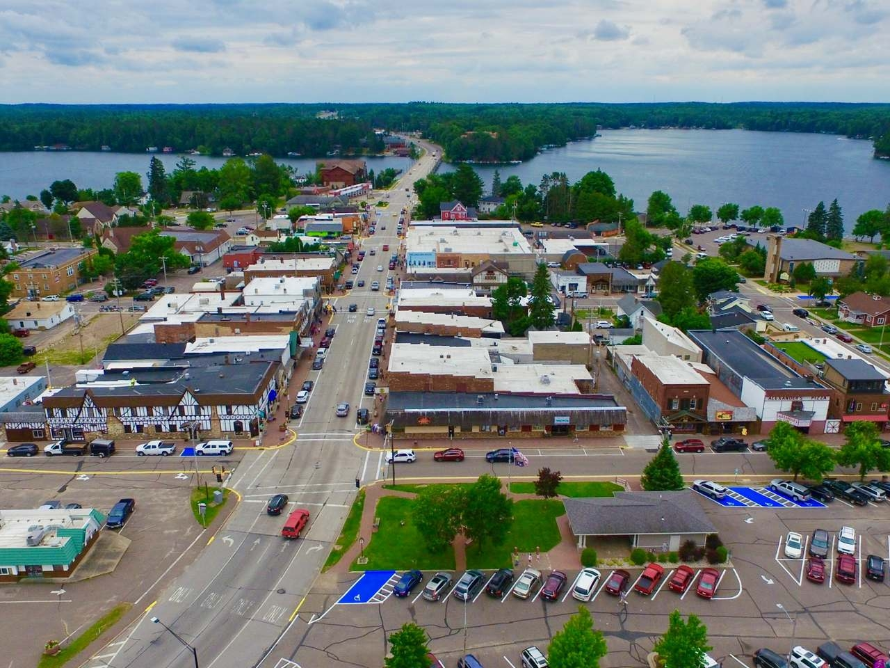 "Thriving Downtown Minocqua retail store with over 10 years of business. Retail store encompasses 1500 sq ft and comes with large attached garage/loading area and expansive basement for dry storage and inventory. Also included are 2 upper unit apartments for extra income potential. These upper units are both 2 BR 1 BA with a large storage unit separating them. ""A Step Up"" is well known in the area for decorating homes with the ""Northwoods Charm"" everyone is looking for. Business comes with great books and nets well. Property is situated in the heart of downtown in the most high trafficked area. The inventory fluctuates and will be addressed outside of the deal."