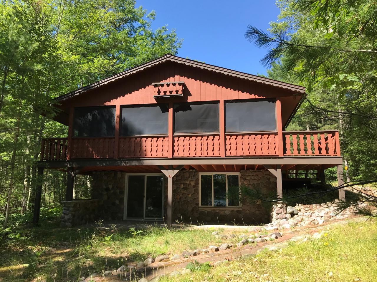 LOOKING FOR PEACE AND TRANQUILITY? You will find it here! This three bedroom, two bath home sits on 301 feet of frontage on peaceful Mitten Lake and has 6 acres of land for privacy. Located very close to the Chequamegon National Forest, it is a great spot to be for hunting. The view of the lake looks like you are in a wilderness area with trees lining the shoreline. The home was completely remodeled by the current owners in 1993. There are two bedrooms and a full bath on the main level. The living area is open concept with patio doors to a screened porch overlooking the lake. The lower level features tile flooring throughout. The family room has a beautiful stone fireplace and views of the lake. A third bedroom, full bath and laundry/utililty room complete the lower level. A two car garage stores the toys you will want to enjoy this wonderful property. And it comes completely furnished, including a pontoon boat to enjoy the lake! LL Bedroom has NO egress windows - New 3BR septic system in 2019.