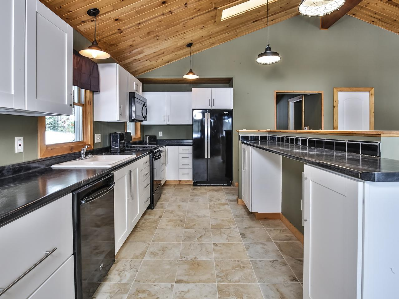 Tremendous rental opportunity on the Eagle River Chain of 28 lakes. This 5 bedroom 2 bath home offers the features you want! There are views of the lake from every angle of the deck and plenty of yard to throw a ball or set up bags. The house is very clean, functional and open. There was plenty of room to spread out. There were endless lakes to choose from whether you wanted to fish or water ski; even a great sandbar nearby. Everything in the home is new, appliances, floors, paint, you name it. The slope to the lake is gentle and the frontage is very nice and offers very good swimming. The pier is large and new and there is a 2 car detached garage. All the conveniences of Eagle River are less than 5 minutes away. Imagine the Chain lifestyle or use the home as a rental!!