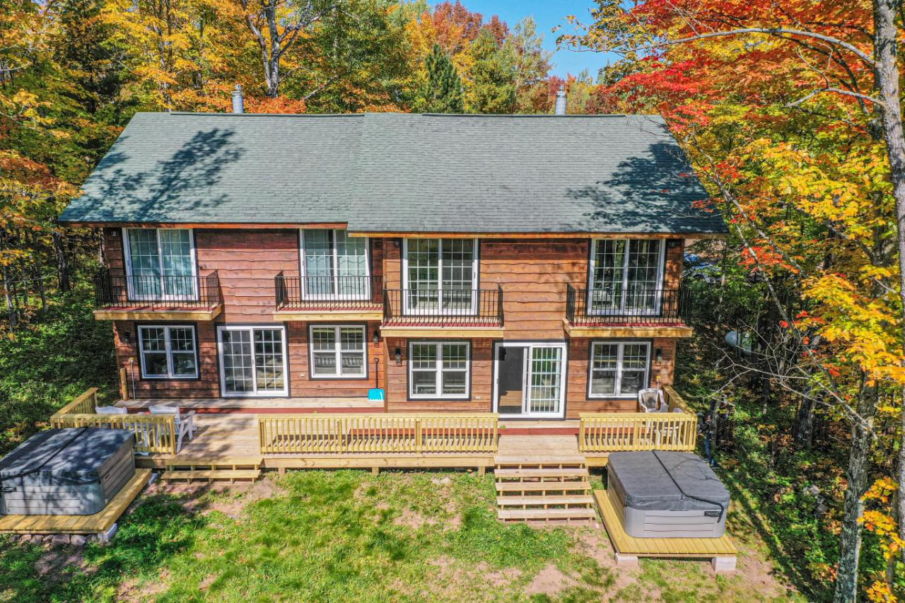 Great Investment opportunity or Multi-Family Home! Ski-In-Ski-Out Duplex Chalet at Big Powderhorn Mountain Ski Resort. The Czech Inn is a trailside duplex vacation home with 6 bedrooms and 6 full bathrooms (3 bedrooms and 3 full bathrooms on each side- a king bed and 2 queen beds). Perfect for families or large groups. This duplex has been completely remodeled and updated including new windows and patio doors, new flooring, new carpeting, newly painted, all new island kitchens, granite countertops in kitchens and bathrooms, new furniture, new cabinets in the kitchens and bathrooms, and all new appliances. New gas fireplaces. 1st floor bedroom has full bath with tub and shower. 2nd floor master bedroom suites have an enlarged ensuite master bath with walk in shower, double bowl vanity and linen closet. The 2nd floor guest bedroom has a new enlarged hall bath with a walk in shower, double bowl vanity, washer/dryer, private balcony & 2-6 person hot tubs overlooking the Alpen ski run!