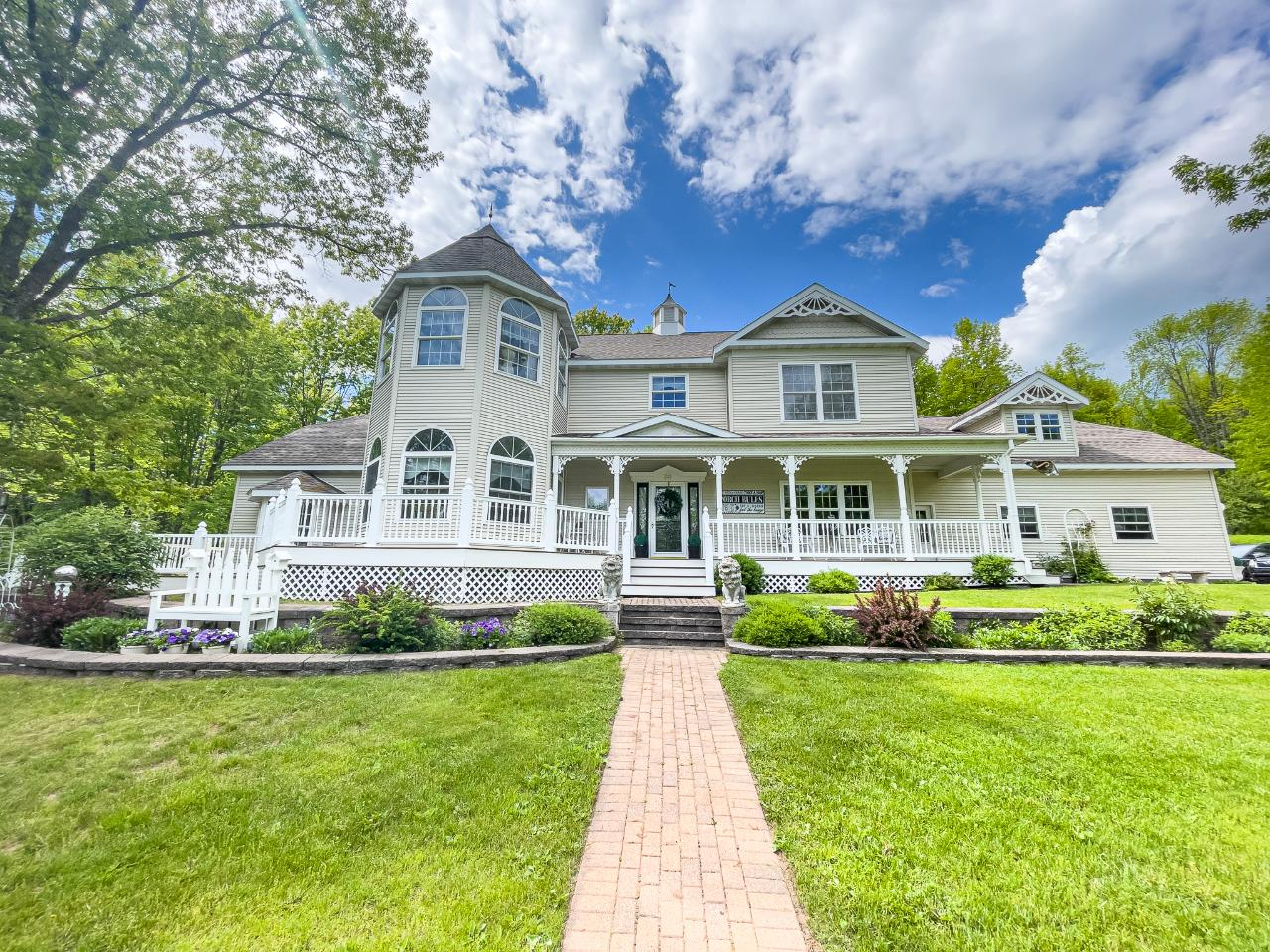 Tucked away on 10.45AC of wooded landscape & inspired by Victorian Home design, this custom-built 3bed/3ba masterpiece features dormers, classic wrap-around porch, decorative railings, ornate trim, stained glass additions, chandeliers, & two staircases. Every square foot exudes keen attention to detail & pride of ownership in this immaculate home. Walk in the front door & be met by the sprawling staircase leading to the impressive second-floor balcony. A sitting parlor with large bay windows adjoins the huge family room. Entertain in style in the formal dining room. A second staircase leads from the formal dining room to the master suite wing on the second floor. This master suite includes huge hobby room/office/library, en suite with fireplace, jacuzzi tub, shower, double vanity, & sleeping area w/sitting room overlooking the property. Classic design, quality construction & a gorgeous landscape all come together to form a truly compelling property for luxury living and entertaining.