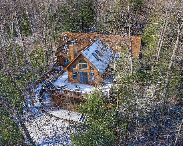 Lovely custom cedar home w/100' of eastern exposure sand frontage & incredible lake views! Centrally located on the famous 3-Lakes/Eagle River Chain of 28 Lakes, w/easy access off of newly paved roads & near a boat landing, features include; soaring wood ceilings, hardwood flooring, a stunning floor to ceiling FP & a lakeside wall of windows. Open kitchen w/peninsula snack bar, main floor master-BR suite & plenty of sleeping space for family/guests in the loft bedrooms, as well as an updated bath w/jacuzzi tub & tile shower! The walk-out LL has a spacious family room, a partially finished BA & ample storage space. The exterior has a covered porch, extensive decking & landscaping, a circular blacktop drive & an insulated attached garage. Storage shed at water's edge, a maintenance-free dock system, an add'l 12' x 14' shed, a drilled well, a 3-BR septic, dual AC units & a newer dual-zoned NG furnace round out this fine offering! This is the Northwood's lifestyle you've been dreaming of!