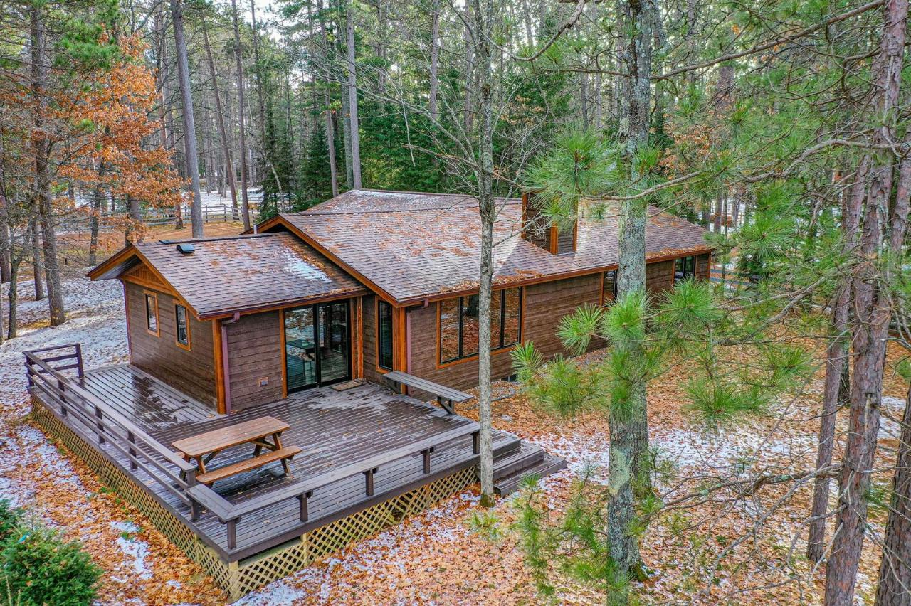 This Little St Germain Lake House has been remodeled like new and is ready for you to enjoy. It is located on a dead-end road with towering pines leading you to your Northwoods paradise. The great room welcomes you to the lake with beautiful lake views, vaulted pine ceilings with recessed lighting, stone woodburning fireplace, & large windows to allow for natural lighting. The kitchen enjoys a breakfast island, gray cabinets with white farmhouse sink, new stainless-steel appliances, & patio door to the lakeside deck. The master bedroom also enjoys the lake view with private full bath & walk in shower. There are two more bedrooms and a second full bathroom with tub/shower unit. The yard is level with a firepit, swing, & very nice sand frontage for swimming. The yard is level and spacious with some large concrete stone steps leading to the dock. There is an attached two car garage, & all new septic, drilled well, roof, Pella windows, new Smartboard siding, & new interior.