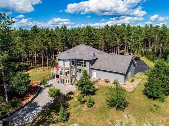 NEWBOLD EQUESTRIAN ESTATE. Stunning, custom built 4 BR, 4 BA on 16 acres with fenced pasture, wooded walking trails, disc golf. 52x32 heated barn w/3 ins. stalls, potential of 4 stalls, auto waterers, heated tack room, wash station, radiant heat avail. 70x130 indoor riding arena w/halogen lighting, natural daylight. Exceptionally designed home with elegance and comfort. Main floor features an impressive foyer, front gathering rm, Master suite, custom Frasier kitchen that will please the most discerning Chef, living room and dining rm. overlooking a beautifully landscaped lot, arena and woods. Laundry/mud room off 3 car att gar and bath complete this level. Upper level features a BR ensuite, and 2 BR that share bath, exercise/office, 3rd story Turret sunroom with gorgeous views. Walk-out LL offers a large family room w/full kitchen, bath, separate entry. Possible in-law suite, in-home business, many possibilities exist. Spectacular property must be seen!