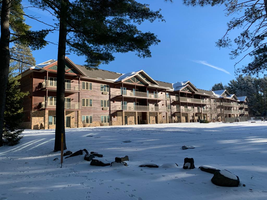 The rarest of rare! This 3 BR, 3 BA condo offers the finest location at the Eagle Waters Resort. It is located in the Kee-Mi-Con Lodge. It is located on the main level and it is a corner unit. It is located at the highly desirable west end where your lake view is terrific. Imagine watching the sunset from your private deck! It offers over 2000 sq. ft. It can be rented as two units, 2 BR-2BA Unit plus a 1 BR-1BA Unit to maximize returns. The unit offers so much more living and dining areas than the other units. The property is located on the famous Eagle River Chain of 28 Lakes. Boating is unsurpassed! There is a swimming pool, hot tub, tennis courts, an excellent restaurant, multiple bars and an outstanding outdoor bar. Eagle Waters is a year-round resort destination that is not only busy in the summer but is a great wedding and snowmobile destination. A perfect place to unwind and create some income too!