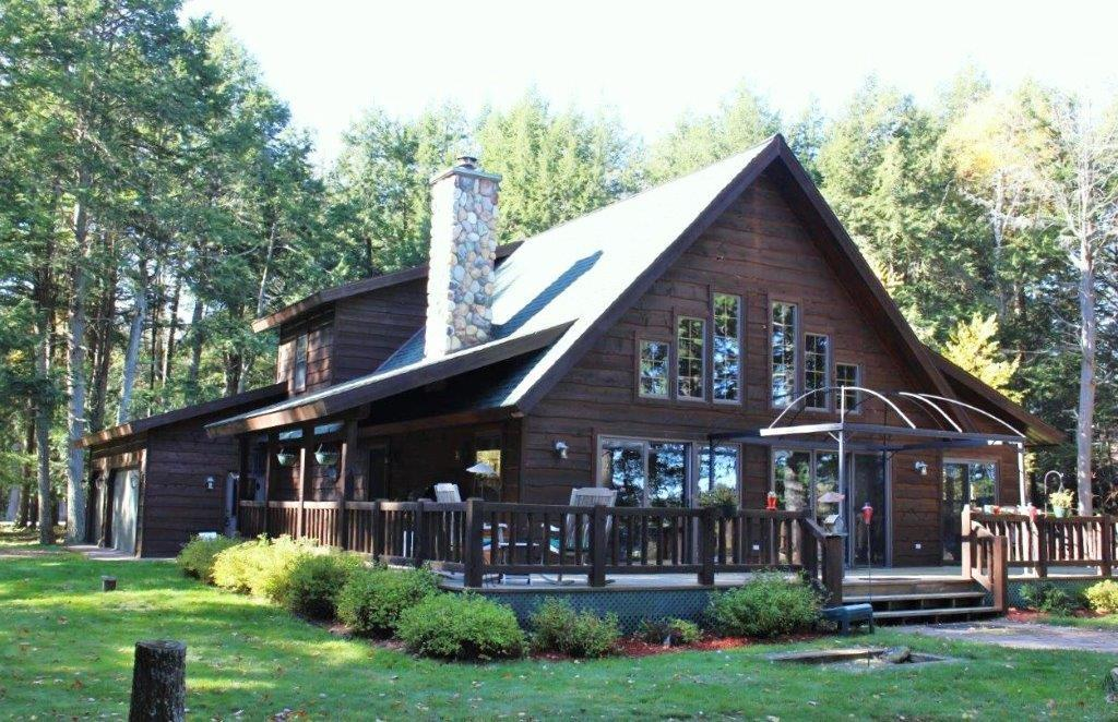 Two Sisters Eagles Point Paradise. Cedar sided chalet with all the right stuff. 2 large bedrooms with a loft and 3 full baths. Open concept great room with floor to ceiling field stone fireplace. Spacious kitchen and cozy sunroom off the dining room. Main floor custom bath and mud/laundry room. Huge family room in the lower level and another custom bath. Oversized 3 car attached garage with interior basement entrance and walk into the mudroom. Full side covered porch entry and massive lakeside deck a true barefoot sand beach for fantastic swimming & great privacy. This Northwoods getaway has all the features on the discriminating buyers top 10 wish list . Home comes fully furnished. All new windows and a credit to buyer for siding repair or replacement due to wood pecker​​‌​​​​‌​​‌‌​‌‌‌​​‌‌​‌‌‌​​‌‌​‌‌‌ damage. All new windows; Buyer credit for siding