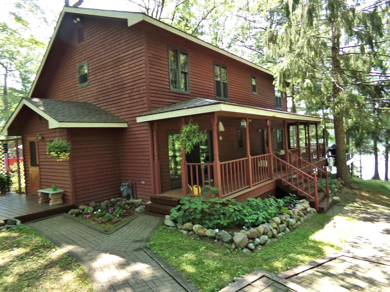 Your peaceful lakefront retreat awaits! This custom 4BR, 2BA, 2-story lake home is on a quiet lake in the heart of the Northwoods. With sunny southern exposure & expansive views of 80% state-owned Mann Lake, the house features 9' ceilings with pine beams, hardwood floors, open kitchen/dining, walk-in pantry, 1st floor laundry, full bsmnt, large master with lake views & walk-in closet, covered porch spanning length of the house, and 3-car oversized garage. New roof, living room windows & carpet. Natural gas & energy efficient furnace. 1st floor bedroom makes for ideal home office (broadband fiber optic internet coming in 2021)! Centrally located between Boulder Jct and Minocqua, 1.5 miles from Hwy 51N and a 10-min drive to grocery stores, schools, boutiques & restaurants. One mile from the nationally acclaimed Vilas County 52-mile paved bike trail system and ½ mile from snowmobile & hiking trails. Mann Lake is a serene, 261-acre lake known for its fishing, wildlife & natural beauty. Off water lots B & C lying north of Mann Lk Rd & bordering State Land is also available to the home buyer.