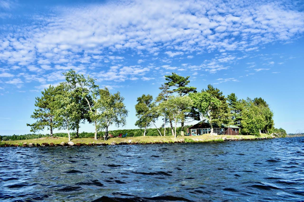 Imagine owning your own private Island for a definite private getaway! On the market for the first time in 80 years. Swimming, boating, fishing, bird hunting, ice fishing on a 3500+ acre lake. This Pelican Lake Island with 1800 ft. of frontage is paired with a 1.2 acre buildable lake lot. The 2 bedroom, 1 bath cottage has all modern amenities: electric power, water, telephone, ac units, and electric heat. Recently remodeled kitchen and new bathroom. Cottage has metal roof, new deck, beamed ceilings and walls of windows. There is a wood burning fireplace in an open concept living area. There is an outdoor shower, fire pit area, sand swimming frontage and large trees. The Lake Lot has 100 ft. of frontage with 280 ft. of depth for plenty of room to build a year round home. It has a 2 car garage, western exposure, gentle slope to the water, beautiful sandy beach for swimming and provides for easy island access. Buyer to verify all measurements.