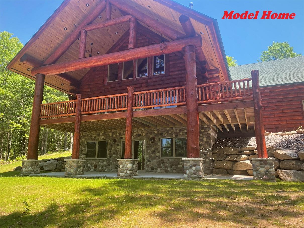 """RHINELANDER CHAIN NEW CONSTRUCTION! Picturesque hand-hewn, log sided home set on 1 acres w/ 104.95 feet of waterfront on the Rhinelander Chain of Lakes! Over 1372 acres of water to boat & fish, or cruise to a restaurant on this is a perfect body of water no matter what your interests. Big water views through a wall of windows, covered main level deck & covered lower-level walkout give you the ultimate access to the water from almost every level. Nicely wooded lot offers good privacy as part of the Birchwood Shores North Condominiums. This small condominium development maintains the true """"Northwoods Feel"""" w/ minimal HOA fees for road & common element maintenance. Located on a no thru road the driveway is off a Cul-de-Sac private road. This executive home offers 3 bedrooms, 2.5 bathrooms, including the master suite w/ a large walk-in closet & many other unique custom upgrades. This home is under construction at the time of listing. Unit 1 (1.9A w/ 109ft) available for additional $100K. Lower level stubbed in for 4th full bathroom. Home under construction. HOA fee $250/unit. Unit 1 available for $100,000 w/109 ft. of frontage, 1.09 A."""