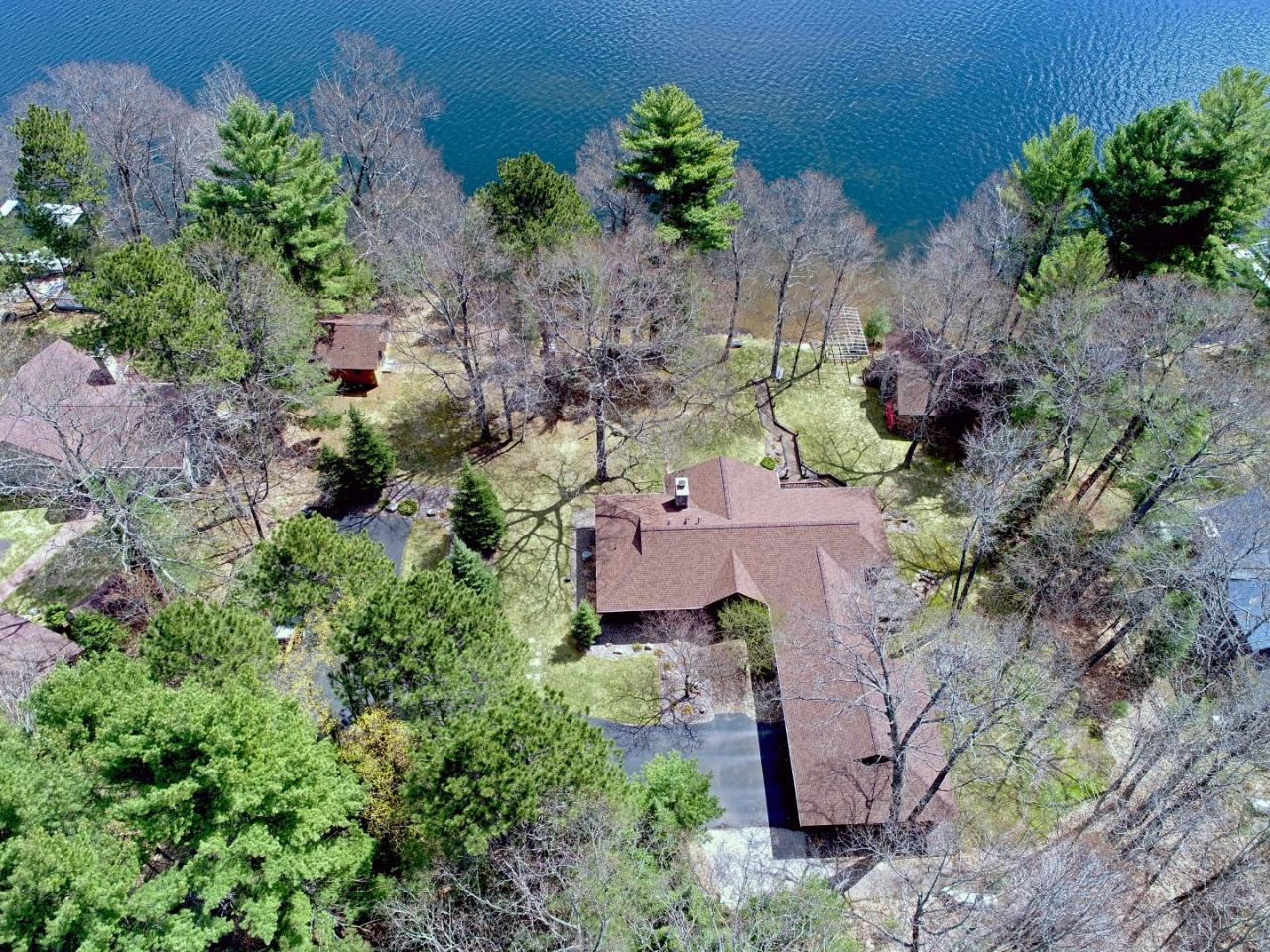 Gorgeous 4BR, 3BA main home on the Minocqua Lake Chain with an added bonus of two guest cabins. Enjoy 223' of sandy frontage on Lake Kawaguesaga with a level and beautifully landscaped yard. Plenty of storage for extra toys & vehicles. Thoughtfully laid out property with a private setting for maximum relaxation at the lake.