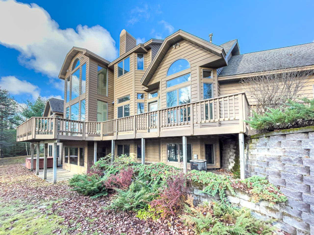Harris Lake MASTERPIECE on 2.24 acres w/211' of sand frontage! The towering entrance leads to a huge living room w/magnificent 28' high ceiling + massive Lannon stone FP. A chef's kitchen has a double oven Viking range, Sub-Zero refrigerator, wine cooler, cabinetry of the highest quality & much more! The master suite includes a 2-way FP, huge bath, WIC, Jacuzzi tub, separate shower & large vanity. Two more large BRs, full bath, luxurious wet bar room/den, 1st flr laundry, lovely sitting rooms & much more round out the main floor. Upstairs, there's 4 more BRs & 2 full baths along w/loft overlooking the living room and entrance. Beautiful water and woods views from every room! The huge lower lvl features a giant masterfully finished family/rec room, W/O to patio area plus several storage areas along w/mechanicals. A spacious 3-car att garage has a large finished bonus room above for extra room! Sellers prefer to sell furnished. Northwoods luxury living at its best--see it now! Home is in process of being repainted. Painting will be complete by closing. NOTE: Fire number was changed by the township from 14266 to 14263.