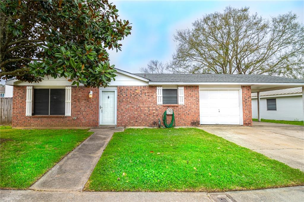"All brick ranch style 4 bedroom home on ""no through traffic"" street.   Large covered carport and back patio.  Spacious backyard.  Great for entertaining."