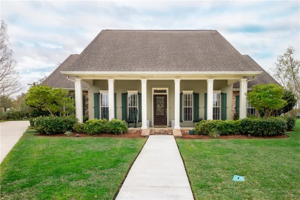 Pristine custom built home located in desired Ingleside subdivision off Main St. Open floor plan features granite & custom cabinets in kitchen, hardwood floors & tile throughout living/kitchen areas, spacious bedrooms with separate shower and garden tub in master suit, sunroom/sitting area by fireplace with view of backyard. Covered patio for entertaining. Detached brick storage area with rear yard access at back of home. Home has only one owner. Has been freshly painted.