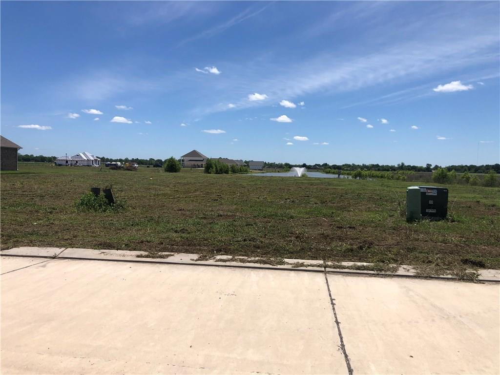 Oversized lot on the water in beautiful Bellevue Lakes Estates.