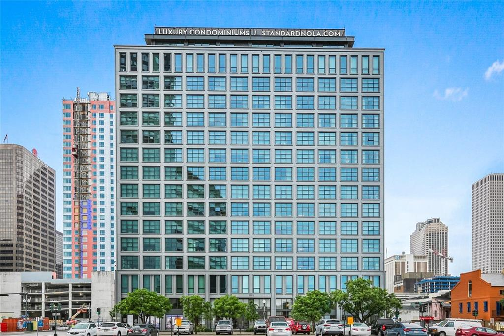 Welcome home to The Standard, where luxury amenities meets effortless living on Gallery Row. Enjoy South face views in this stunning 9th floor unit. Expansive windows, 10 ft ceilings, spectacular Morris Adjmi-designed chef's kitchen with locally-crafted walnut cabinetry complete this seamless floor plan.  Unit is exclusively refined by Kelly Sutton with Sutton House of Design, elevating the space with her signature, chic, timeless New Orleans style.  A must see, make an appointment for a private tour today.