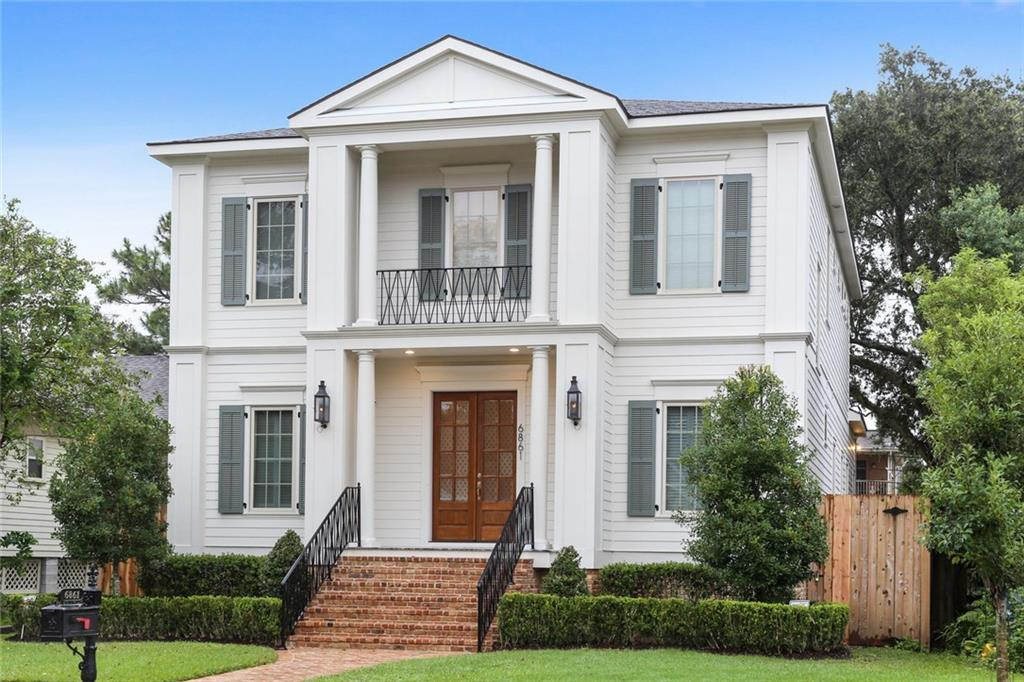 LAKEVIEW LUXURY 5 YEARS YOUNG! 5 BDRMS 3 1/2 BATHS, 2 LAUNDRY ROOMS 1 UP 1 DOWN WASHERS AND DRYERS REMAIN, 10 FT CEILINGS WITH 12FT TREY CEILING IN MAIN BDRM AND 20+ FT FOYER CEILINGS, BUTLERS PANTRY W/ ICE MAKER & BEVERAGE REFRIGERATOR, POT FILLER, STAINLESS APPLIANCES, GAS COOKTOP, WOOD FLOORS & TILE THROUGHOUT, NEST THERMOSTATS, SECURITY SYSTEM W/ CAMERAS, WALK IN ATTIC, OVERSIZED BASEBOARDS, GATED CARPORT PARKING, FARMHOUSE SINK, CASEMENT WINDOWS, KITCHEN PREP SINK, PLANTATION SHUTTERS & MORE!
