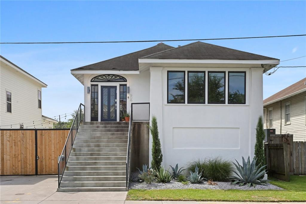 Renovated in 2019 down to the studs. This home delivers modern luxury and a functional design. Second level is complete with a stunning kitchen, professional-grade appliances, large island & chic recessed lighting; master suite with spa-like bath, freestanding tub & separate shower; another spacious bedroom & bath plus laundry. The 1st level has 3 additional large bedrooms, 2 full baths, second living room, laundry room, huge closets & home gym. The pictures don't do this home justice; this is a must see!