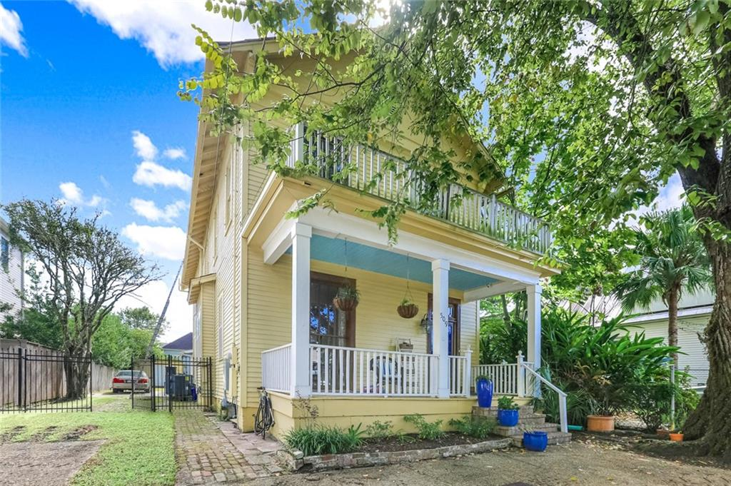 INCREDIBLE LOCATION!  Charming Victorian home is just two short blocks to Audubon Park.  Original natural woodwork throughout the house which includes French doors, pocket doors, and a cedar closet.  This jewel needs updating but has the original hard wood floors, floor to ceiling windows across the front, a porch, balcony, covered patio in rear, a generator for power outages, and a fenced yard.  Enough OFFSTREET parking for 5 cars.  There possibilities are endless, must see to truly appreciate this beauty!