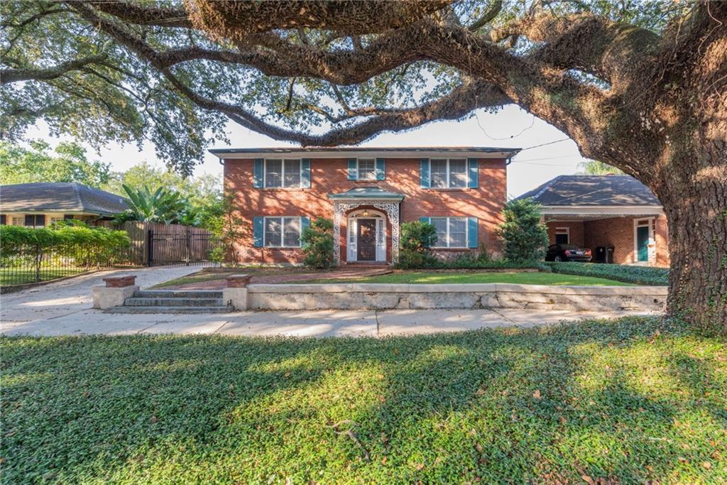 PRIME RENO OPPORTUNITY in the historic Garden District - 1956 traditional brick home steps to Magazine St. and parades on St. Charles Ave. Home has solid bones. Gated parking, carport, and room for a pool. Bring your vision and make your mark. The granite steps in front are the original granite steps to the entrance of the Robb Mansion from 1854, and later as the Sophie Newcomb College.