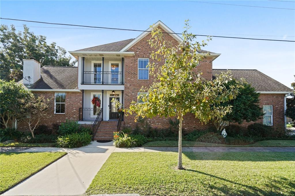 Beautiful brick home on large 80x120 lot and may include an additional buildable 40x120 lot.  The home comes with amenities galore.  For starters Open floor plan, wood flooring, wood burning fireplace, versatile loft playroom, double attached garage, two attics, inground pool with attached spa, fantastic cabana with outdoor kitchen, surround sound system, lovely lush landscaping and so very much more.  You just don't get this chance often in Lakeview to have 120x120 land with home and so much more!