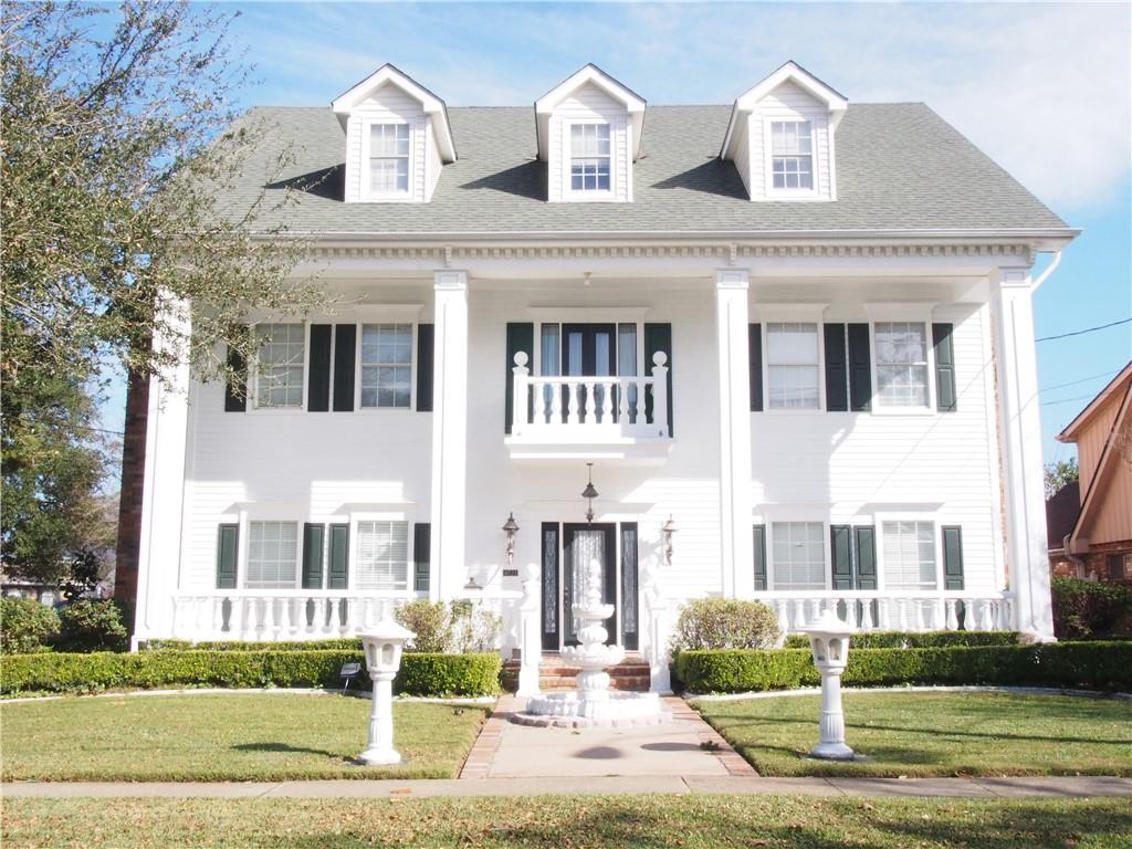 """Beautiful 4 bedroom Colonial home.  Features 10' ceilings down, large Den with open floor plan and a bar for entertaining, fireplace and built in bookcase. Updated Engineered wood flooring throughout Master suite and 3 large bedrooms on 2nd floor.  3rd floor bonus room or use as an office has a half bath and wet bar. House is in """"X"""" flood zone!"""