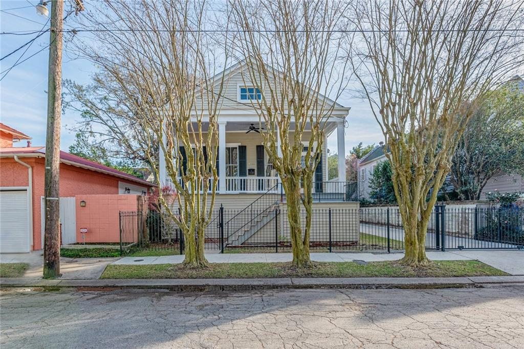 Raised Cottage on OVERSIZED lot Uptown, 1-block to St. Charles Ave., large, covered porch, floor to ceiling windows, boxed columns w/ iron gate. Upper level, 2087 sq. ft., 3 beds/ 2 baths, 12' ceilings, hardwood floors, chandeliers w/ medallions, elegant crown molding, double parlor w/ pocket doors open to impressive dining room. Updated kitchen w/ marble counters & SS appliances. Lower-level w/ approx. 6.5' ceilings, 1672 sq. ft. w/ 2 beds, office, playroom & storage. Gated driveway w/ parking for 3+ cars.