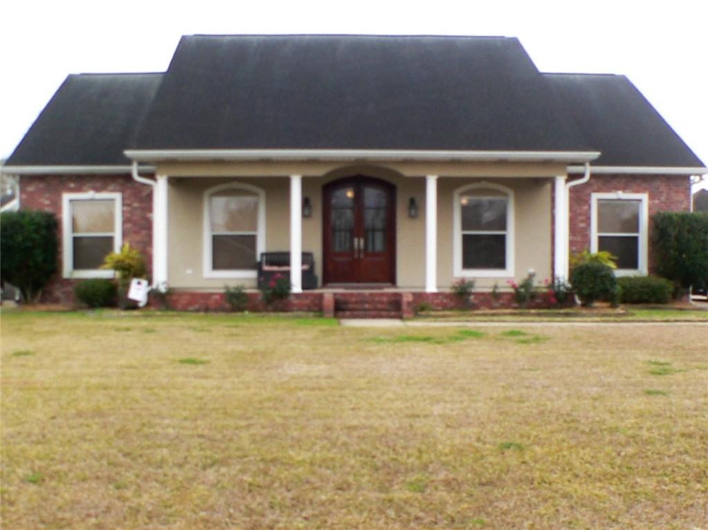 Have it all!  Quiet living in Oak Manor Estates only 20 minutes from New Orleans' CBD.  Beautiful home with an open floorplan has three bedrooms and 3.5 baths on an oversized lot.  Amenities include a wet bar, wood burning fire place, granite counters, stainless steel appliances and a whole house generator.  The garage includes a full bath and a bonus room upstairs and the yard is great for outdoor entertaining.  Must see to appreciate.