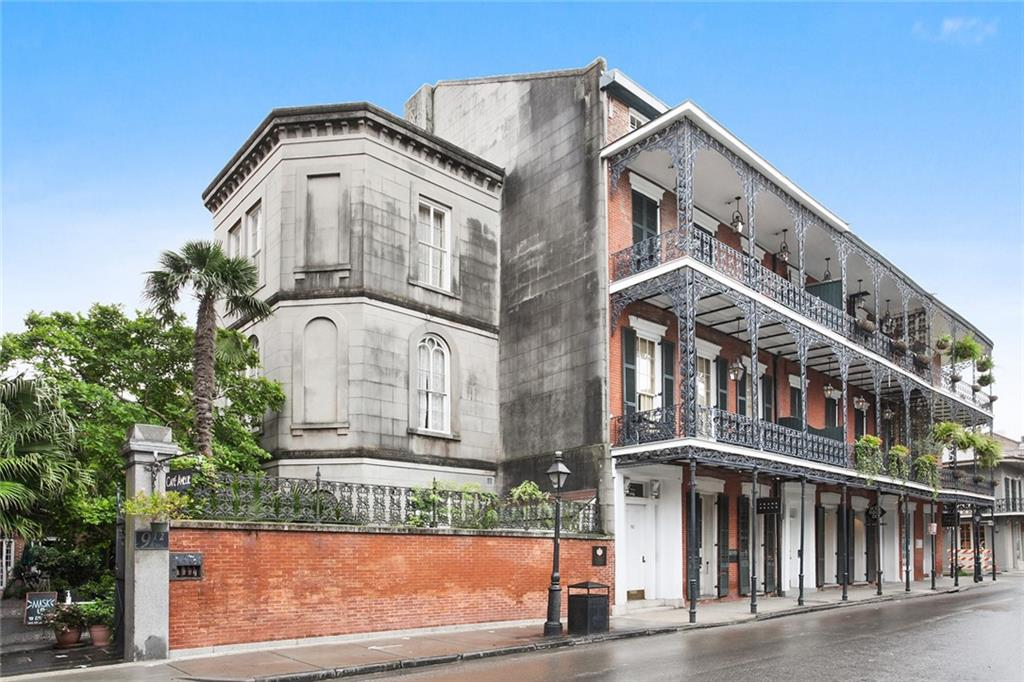 Desirable unit in the FQ's historic Princess of Monaco condo building. After ascending to the fourth floor, you'll be rewarded with an enormous living space, soaring cathedral ceilings, amazing views, large eat-in kitchen & newly renovated bath. Exceptional amount of natural light in the bath, kitchen and bedroom A spiral staircase leads to the hidden bedroom.  Very well maintained building.  Cafe Amelie is located downstairs.  Sold fully furnished including a pool table. A dream escape home!
