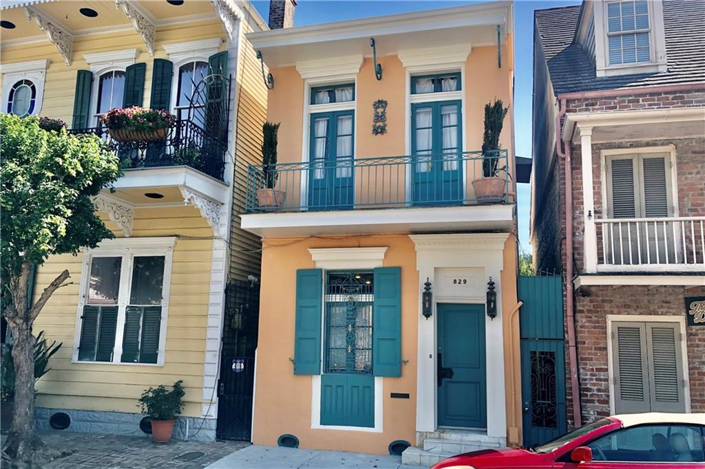 This stunning and petite townhouse is on one of the best streets in the French Quarter! Nestled on a quiet block, but close to all the great restaurants, antique stores, galleries, and liveliness of Frenchmen St.! Features include high ceilings, wood floors, a large living/dining room, modern floating staircase, courtyard with fountain, front & side balconies, and an eat-in kitchen. Put a sofa sleeper in the office/sitting room for an additional sleeping area. The façade is gorgeous!