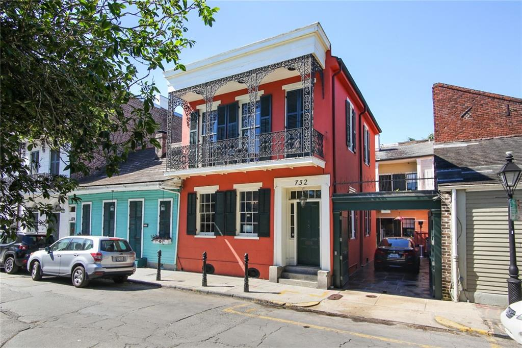 Beautiful Creole Mini Mansion b/t Bourbon & Royal Streets. 3 bedrooms, 3.5 baths. Library could be a 4th BR. 2 car secure parking w/ electronic gates leading to slate courtyard w/ gardens & fountain. Balcony on front of house & around interior courtyard. Only house in the Quarter w/ balcony walk-way on second floor to bedrooms. Zubar hand-painted wallpaper. Custom cabinets in kitchen. Antique Saltillo tile floor in kitchen & adjoining tv room. See attachments for complete description of this splendid home.