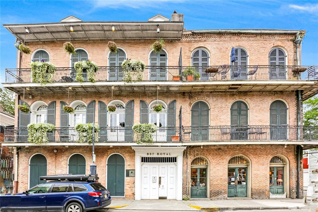 Exceptional property located on the corner of Royal & Dumaine Street- easily one of the most beautiful properties in the French Quarter! Featuring lush ctyd. area with pool/elevator access to condos. This gorgeous 2nd floor condo opens into double parlor/dining & includes 2 levels with 2BR's/2BATHS. Fully renovated with all updated appliances, fixtures, floors + private balcony overlooking Royal St. Lower level includes 2nd BR/BATH + with doors opening to Royal giving guests private access to lower level.