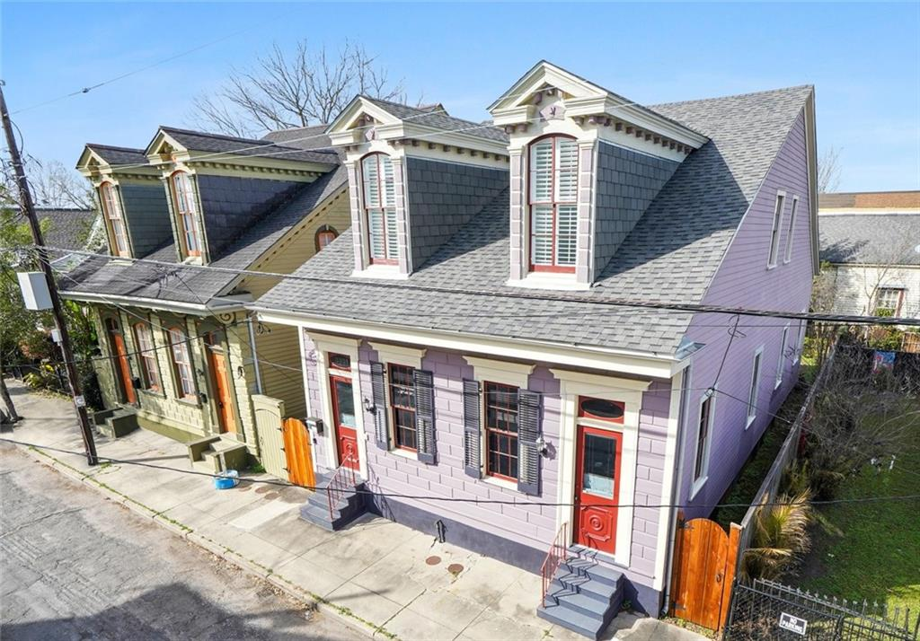 This gorgeous Creole Cottage blends such historical elements as beautiful heart pine wood floors, 12'+ ceilings, transoms, & exposed beam ceilings into a modern setting.  Downstairs primary bedroom w/spacious closet & spa-like bathroom, independent laundry room, in-home office, plentiful storage, cute backyard w/pergola, & prime location make this the ideal home. Electric, plumbing, HVAC, tankless water heater, & spray foam insulation all 10 years young. New roof-2017. Offered below 11/2020 appraised value.