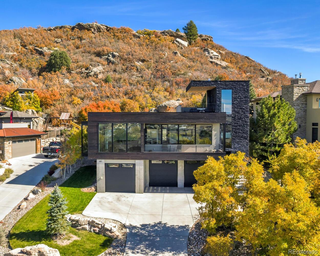 """Whether looking through the floor-to-ceiling windows from the heart of the home or sitting on one of the three outside decks, you will be in awe of the breathtaking views that span over downtown Castle Rock - from Pikes Peak to Mt. Evans and perfectly framed by the town's namesake """"The Rock"""". The commanding exterior compliments the views with this masterfully designed modern 3 bed/ 2 bath luxury masterpiece. Need additional bed/bath? We have a solution for that.  The stunning custom-built steel staircase paired beautifully with hardwood flooring welcomes you into the open main floor living flooded with natural light. The Kitchen flows into the dining and family room which is complete with black stone feature fireplace wall.  The chef's kitchen is equipped with Premium Quartz Countertop, Jennair induction cooktop (it's even better than gas!), Samsung built-in microwave/oven combo featuring flex dual lower oven and steam cooking and commercial grade hood that is perfectly accented by full glass wall tile backsplash.   The master suite features oversized custom master shower and large master closet. Backing to a private """"mountain open space"""" enjoy the privacy of the rooftop deck or back patio. All 3 decks feature IPA Brazilian hardwood floor and cedar ceilings. Additional perks include 3 car oversized heated garage with 9ft tall garage doors, laundry room with """"Dogs Quarters"""",  dedicated dog grooming station and home theater.   Nestled into an amazing neighborhood this property is walking distance to one-of-a-kind restaurants like Tribe, charming shops like The Barn, and community events at Festival Park in the historic downtown. See Supplements for additional details."""