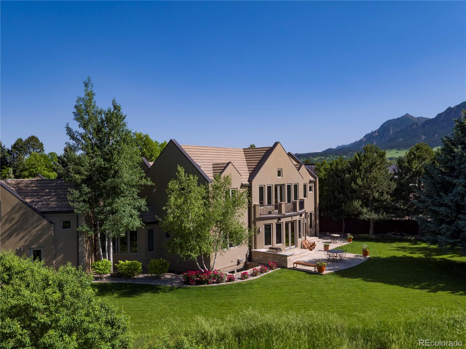 A stunning 1.29-acre oasis with huge, unobstructed views just minutes from downtown Boulder. 7BD/7BA, 6000+SF luxury residence. Main level features large indoor-outdoor living spaces, chef's kitchen, laundry and a bedroom suite. Four more bedrooms upstairs including enviable master suite with two walk-ins, private balcony and a spa bath. Amazing finished basement level with wet bar, wine room. rec room and two more bedroom suites. 2+ car attached garage. Expansive landscaped grounds and patio.