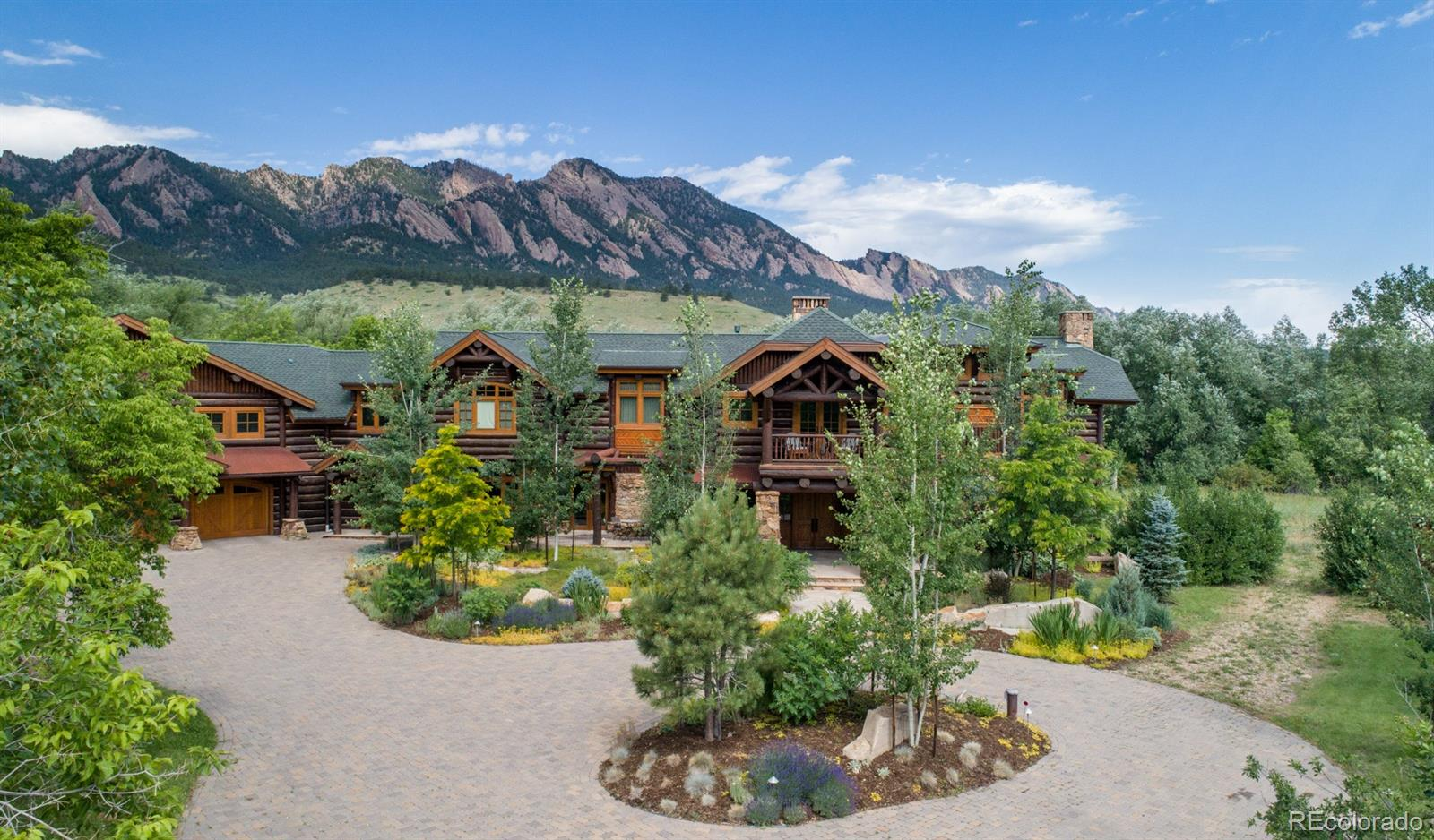 Eldorado Springs area Luxury Home crafted by master artisans. 4 bedrooms, 6 baths, 3-car garage, main floor guest suite, premier neighborhood, privacy and breathtaking mountain views, 5+ acres on S. Boulder Creek, minutes to central Boulder, easy access to Denver and Golden.  Outdoor activities hiking, cycling, climbing, horse trails.  Superb living with state-of-the-art amenities: Gourmet Chef's kitchen, multiple entertaining areas, 5 fireplaces, grand master suite, impressive views from nearly every room, luxury outdoor/indoor living, oversized spa, BBQ, Creekside patio with fire pit.