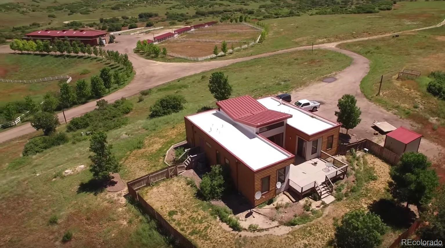 RANCH / EQUESTRIAN PROPERTY w/ UNBELIEVABLE VIEWS! This property has two contemporary homes and 18 stall barn. The homes each have 3 bedrooms, 2 bathrooms, open floor plan, plenty of windows and sliding glass doors providing lots of natural light, fenced yards, and picture perfect views of the mountains and front range. The barn offers everything an equestrian would need, including 18 stalls, tack rooms, vet room, office, laundry, bathroom, and additional storage. The property is located adjacent to Open Space on the East, and includes Water Rights! Don't miss this opportunity to live in seclusion, yet be 30 minutes within retail shopping, dining, and plenty of outdoor areas (Chatfield Reservoir, Deckers, Waterton Canyon). Almost $1,000,000 in Water Rights on 3 different aquifers.