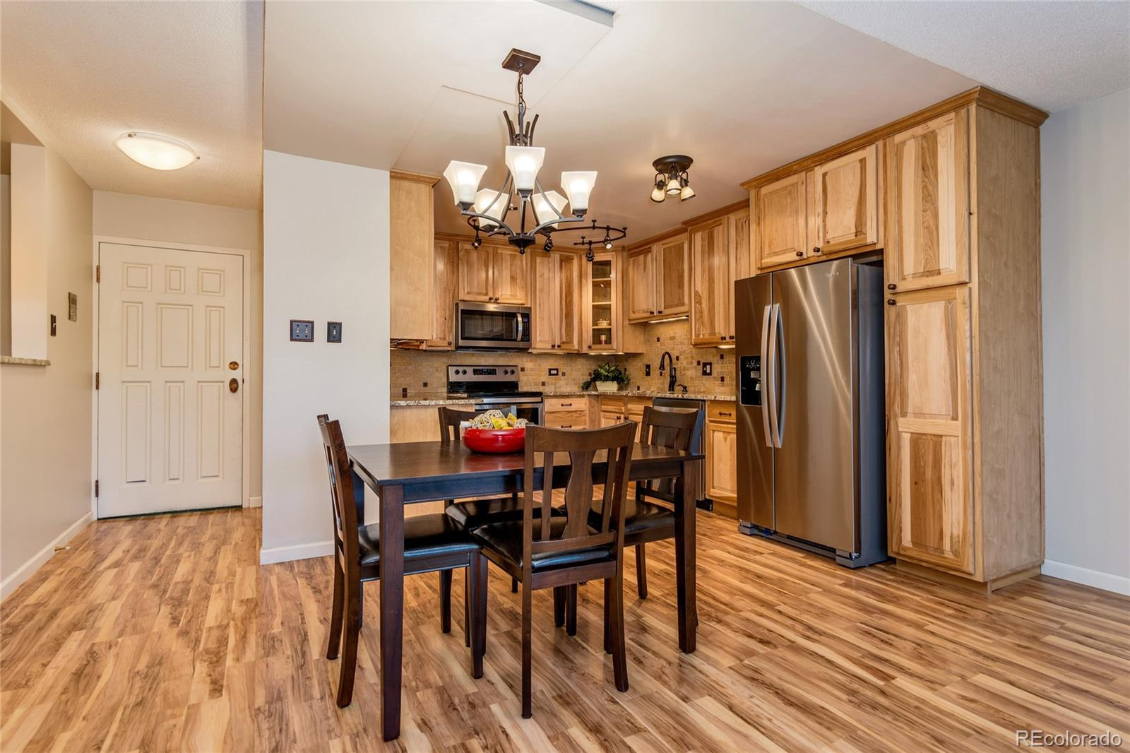 Rare opportunity= fully remodeled 1380 sf G floorplan in Windsor Gardens, only one available w/2 garages! *Tour Windsor Gardens Online: Community tour, explore amenities and features, check out examples of interior walking/narrated condo video tours, and more:  go to www.tourwindsorgardens.com * Great courtyard views! Building backs highline canal & walking trail. 2 bed/2 bath + den that has french doors; can be 3rd bedroom. Kitchen features hickory cabinets, granite slab counters, tile backsplash, updated fixtures, and all new stainless appliances. Bathrooms w/tile floors, newer vanities, granite tops, and fixtures. Awesome built-in office space + bonus utility closet. Wood flrs thru-out main living area. New paint. 3 wall a/c units- one is new with remote. Enclosed glass/screen lanai overlooking courtyard, 2 new vinyl slider doors included! Bonus storage room on same floor. Colorado's largest active adult living community, age 55+. FHA/VA approved. HOA Dues include annual property taxes! And also heat, water, sewer, trash, 24-hour patrolling community responder, club house w/indoor & outdoor pool, hot tub, sauna, activities...9 hole par 3 golf course open to the public.