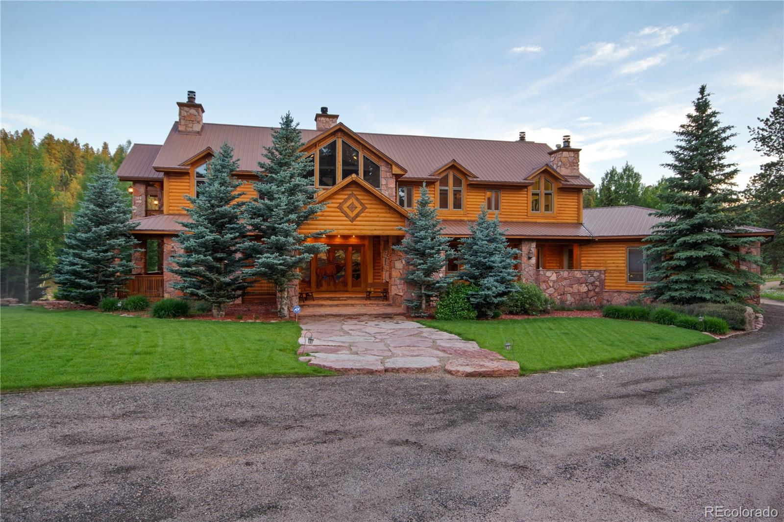 Once in a lifetime, an opportunity comes along to own a spectacular Colorado ranch in the Rockies. This 113 acre ranch is 45 minutes west of Colorado Springs, and the Colorado Springs airport has a 13,500 foot runway. Welcome to Sunrise ranch, the essence of a luxury gentleman's ranch. As one opens the hand-carved and stained glass, wooden doors, one becomes enveloped in the log and stone home. The house is located and 9,000 feet altitude and is a large estate - offering all the amenities one would expect in a first-class property. The main residence is 9,7779 sq ft and overlooks a trout-stocked pond. The 6,000 square foot freshly stained redwood deck, overlooks the water. With various outbuildings, the estate comfortably accommodates 20+ people, making it perfect for a family destination, corporate retreat or hunting lodge. You will find a diverse range of animals on the property for hunting and fishing. The possibilities are infinite with this extraordinary piece of property.