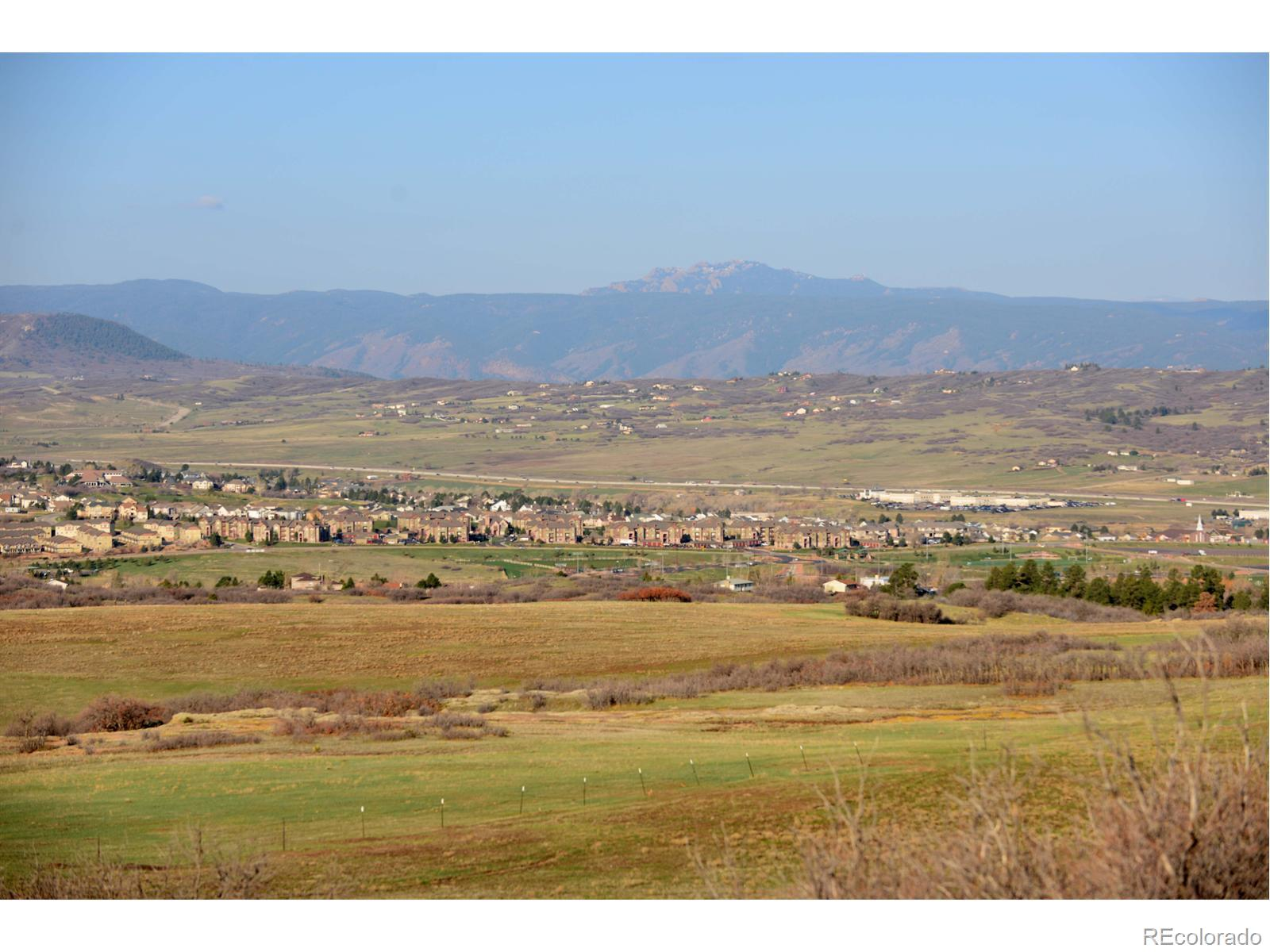 GORGEOUS LAND WITH TERRIFIC VIEWS, ZONING IN PLACE FOR 1,035 UNITS, KING SOOPERS IS JUST ACROSS THE ROAD, APROX. 176 ACRES - ONE OF THE LAST GOOD DEVELOPABLE ACREAGES IN CASTLE ROCK!