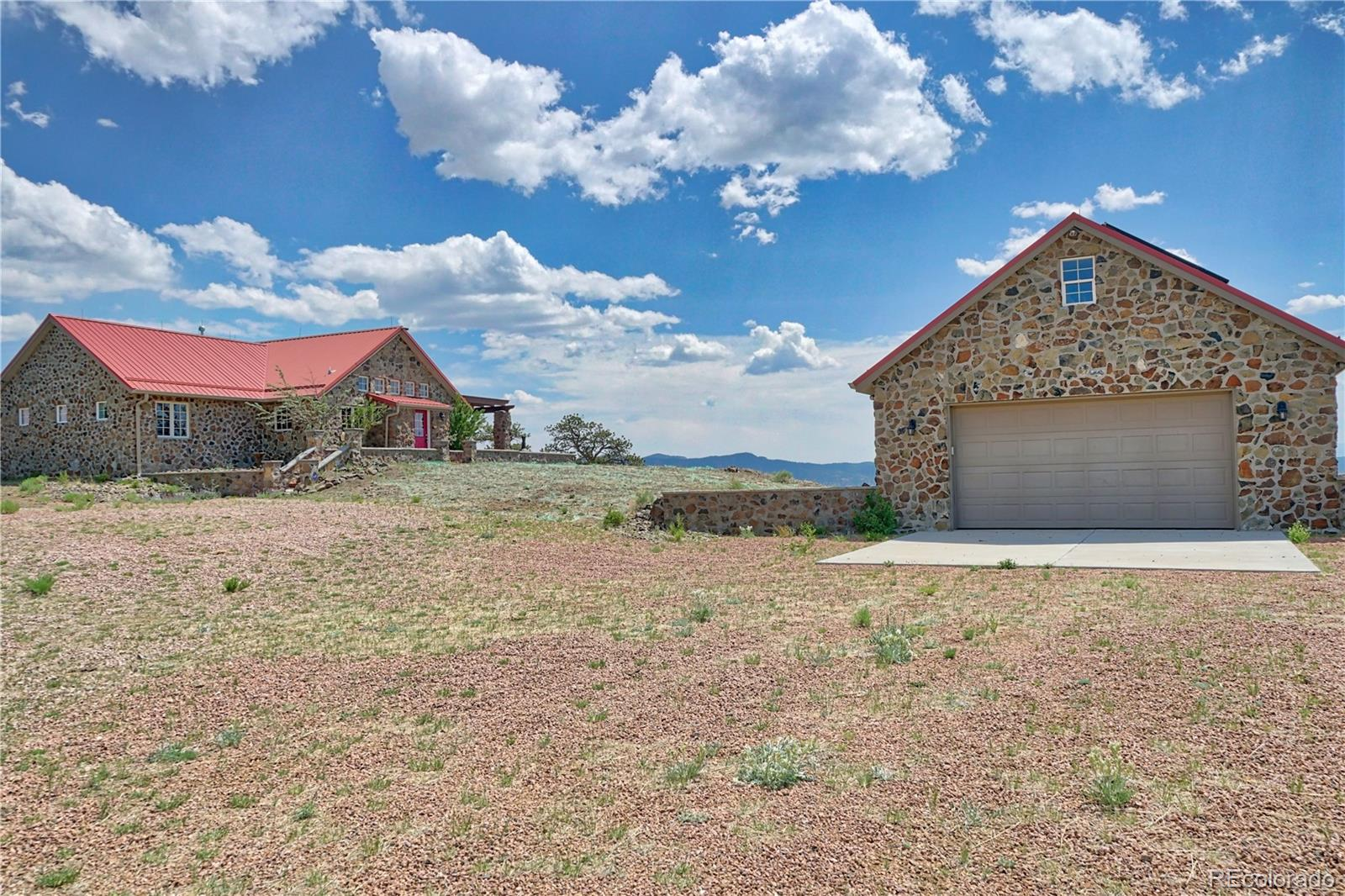 """Properties offering this many surrounding recreational opportunities and views, combined with the right combination of improvements, don't come along often. The 3-bedroom, 3 bathroom home is located on 156-acres and was fully renovated in 2012. Come and take a look at the 360 degree views of 11 Mile Reservoir, Pikes Peak, South Park and the Collegiate Peaks. 11 Mile Reservoir is within 5 minutes. BLM is adjacent to the SW corner of the parcel and adjoins Forest Service lands just to the south.  The ICF construction and stone exterior make the home very energy efficient. The detached garage is heated and contains a tandem bay for vehicles and an RV/trailer. Heat and electricity are fully-integrated off-grid sources (solar panels, redundant generator and propane). Spinney Mountain Reservoir and the coveted """"Dream Stream"""" are also within 10 to 15-minute drives. See attached map of surrounding public land and state parks. Existing furniture can be negotiated as part of the sale or removed."""