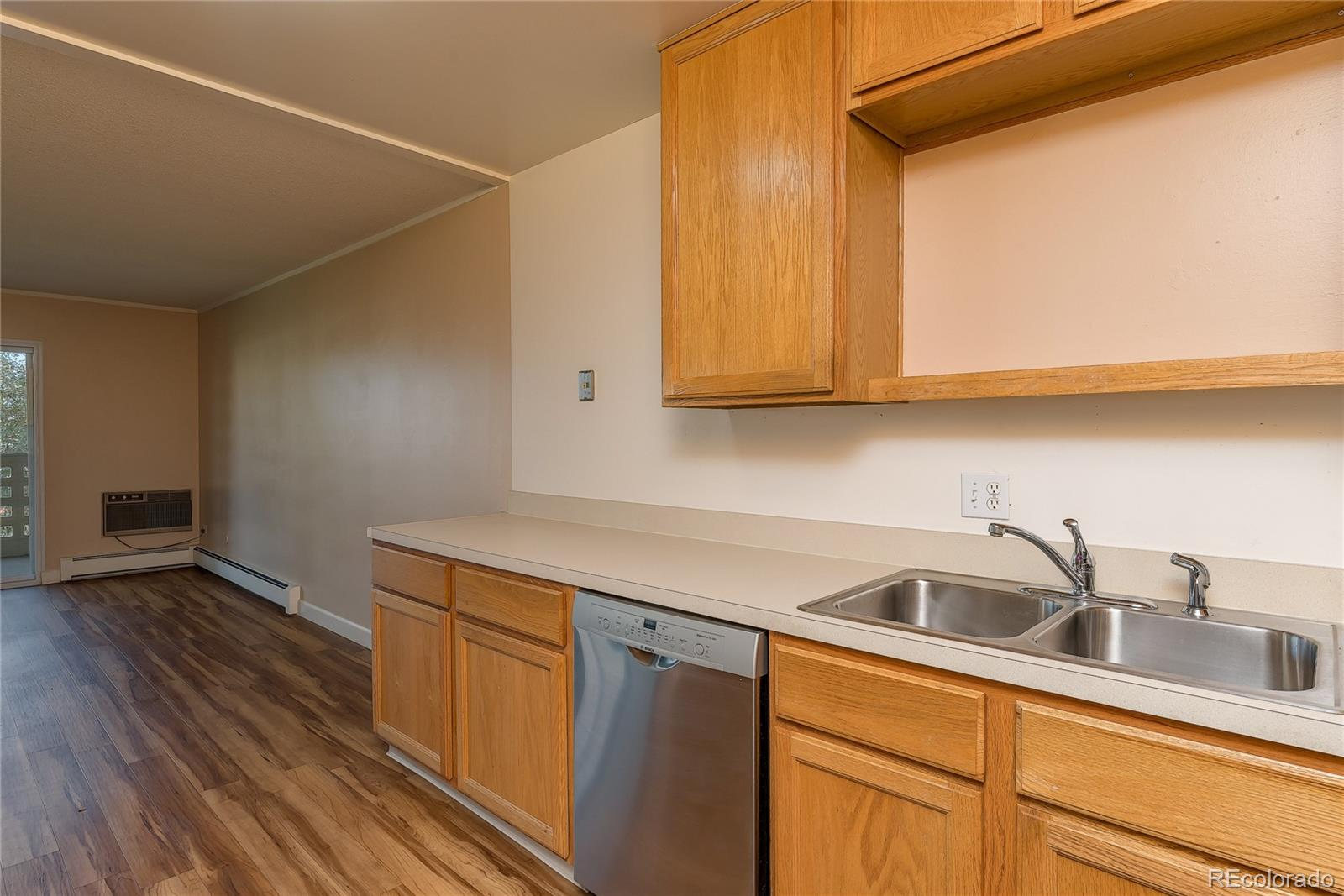 Remodeled and move right in to this 1200 sf, 2 bedroom, 2 bathroom, with underground parking! *Tour Windsor Gardens Online: Community tour, explore amenities and features, check out examples of interior walking/narrated condo video tours, and more:  go to www.tourwindsorgardens.com * Building is across the street from the clubhouse, and all the amenities. Condo location is on 2nd floor, same floor as the laundry room and bonus storage room. Kitchen features updated cabinets and stainless appliances. Coretec flooring thru-out, updated paint, baseboards, fixtures...new double pane slider door to lanai. 2 smart TV's included! 2 wall a/c units. Colorado's largest active adult living community, age 55+. FHA/VA approved. HOA Dues include annual property taxes! And also heat, water, sewer, trash, 24-hour patrolling community responder, club house w/indoor & outdoor pool, hot tub, sauna, activities...9 hole par 3 golf course open to the public.