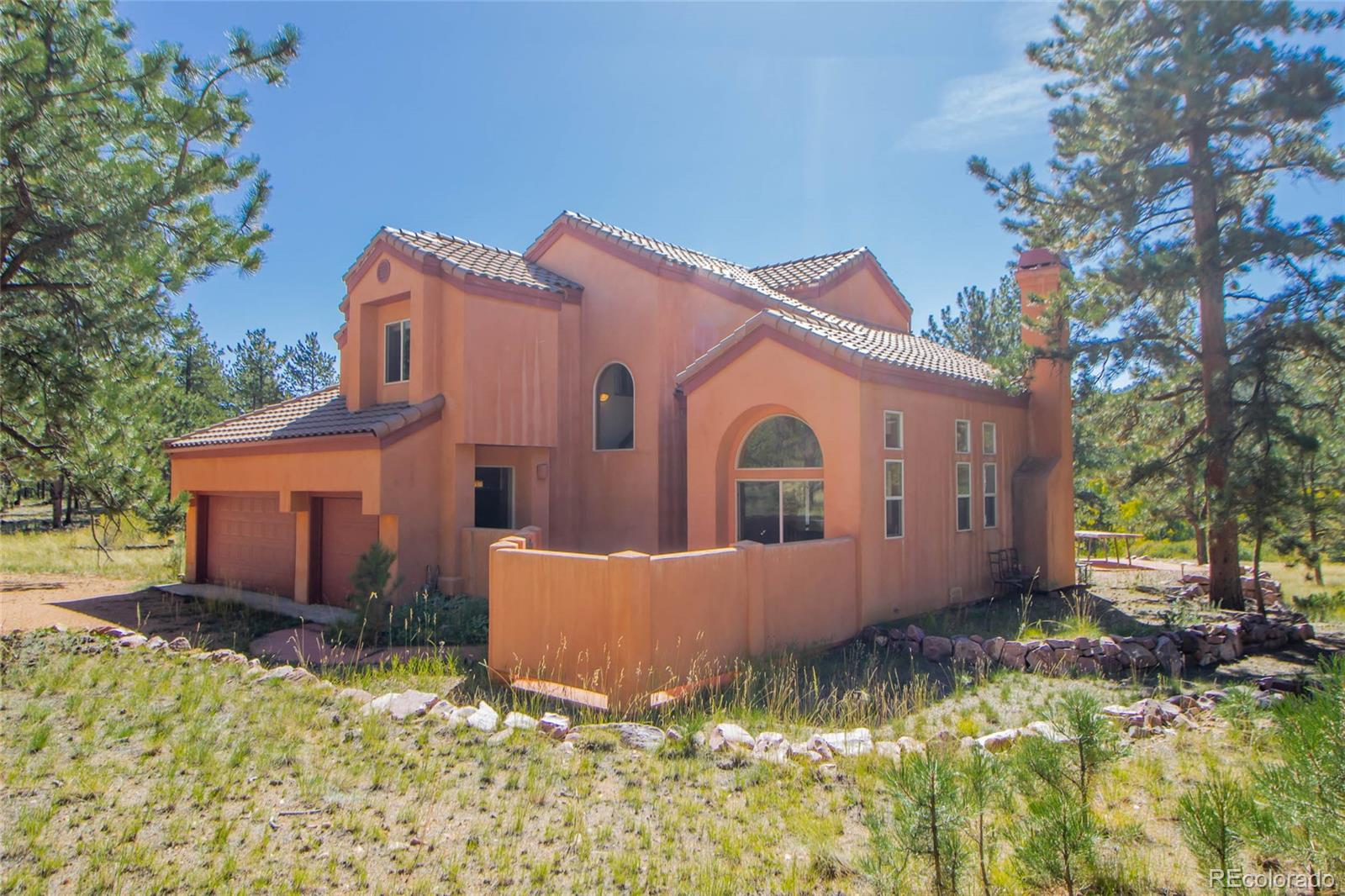 Enjoy the Good Life in this Mediterranean-style home on nearly 4 acres with legal access to National Forest & minutes to all the fun at 11-Mile Reservoir! This low-maintenance stucco home has tile roof, concrete patios, & sits on fully usable level lot. Vaulted ceilings, cozy gas fireplace, & lots of natural light shining through windows that take full advantage of the southern exposure. 2 upper-level Master Suites, one featuring a 5-pc Bath with double vanity, jetted tub, and over-sized shower with seating inside.  The other Master Suite has private Full Bath and French doors leading to its own Sitting Room. Open-concept design Great Room has French doors that lead to landscaped back patio. 3-car garage with ample space for toys and plenty of room outside for RV parking. Easy access year-round to county- maintained roads. You'll love coming home on this scenic drive through open landscapes, rock outcroppings, and majestic vistas that feel right out of a picture book!
