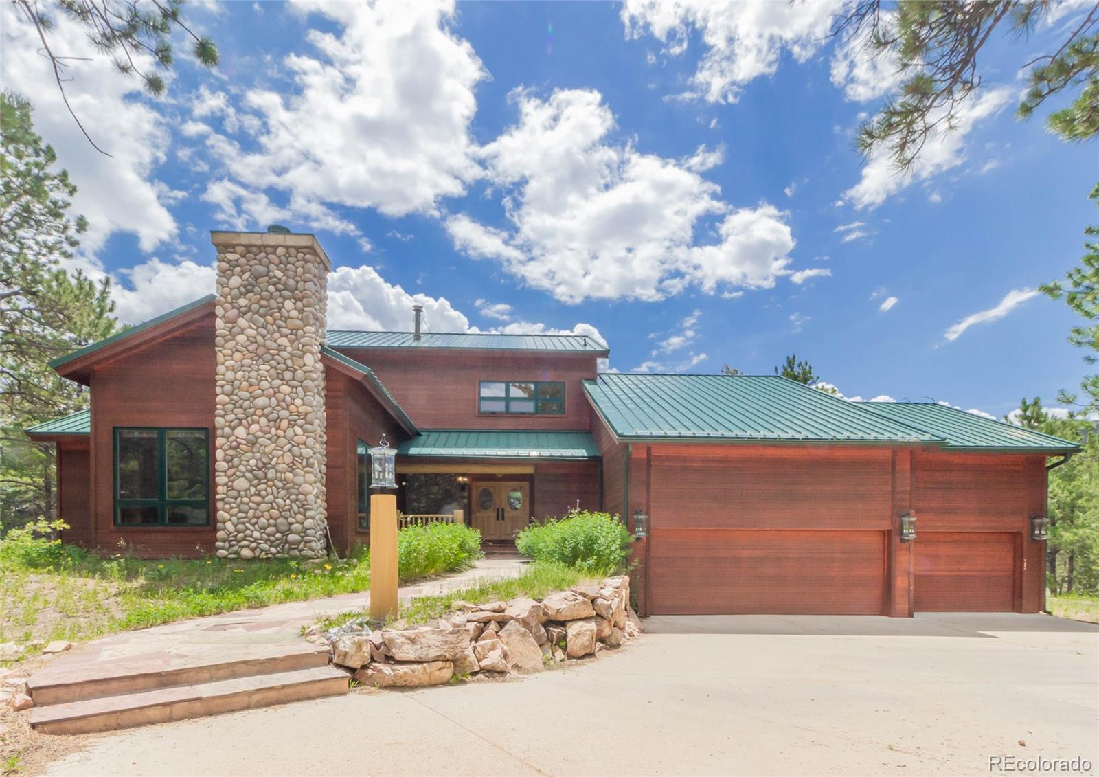 Amazing mountain home on nearly 8 beautiful acres bordering Natl Forest. 6860 sqft custom home is perfect for living the mountain lifestyle, only minutes to 11-Mile Reservoir & Gold Medal waters!Entering the etched glass front doors, jaw drops & eyes draw to beamed TNG cathedral ceiling.Great Room has rock fp/hearth & wall of windows with 3 sets French doors walkout to huge wrap deck & massive screened-in Porch!Kitchen with center island prep sink, built-in wine rack, wood floors/cabinetry, & Dining area! Main level Master is spacious with vaulted ceilings, private fireplace&adj Bath.Up full-log stairs,find built-in bookshelves,Office, 900 sq ft Family Rm,& 2nd Master Suite with sitting area and adj Bath!Downstairs 2 Bedrooms each with priv entr, seating,&en-suite vanity.Lower has Laundry, Full Bath,& tiled Steam Rm! Direct access to Pike Natl Forest, easy access to county road all year. This is a unique custom home with many special amenities…don't let this opportunity pass you by!