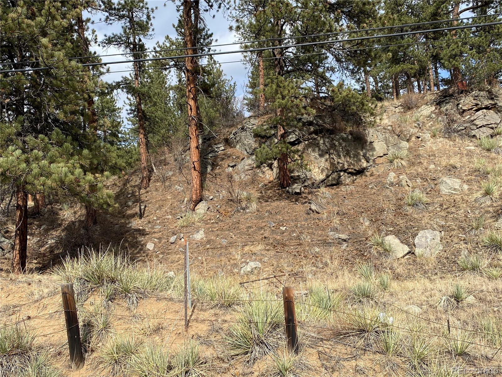 Good Value for hwy 285 one of the last remaining lots in Downtown Bailey.. views * direct south exposure* sloping* ROCK OUTCROPPINGS