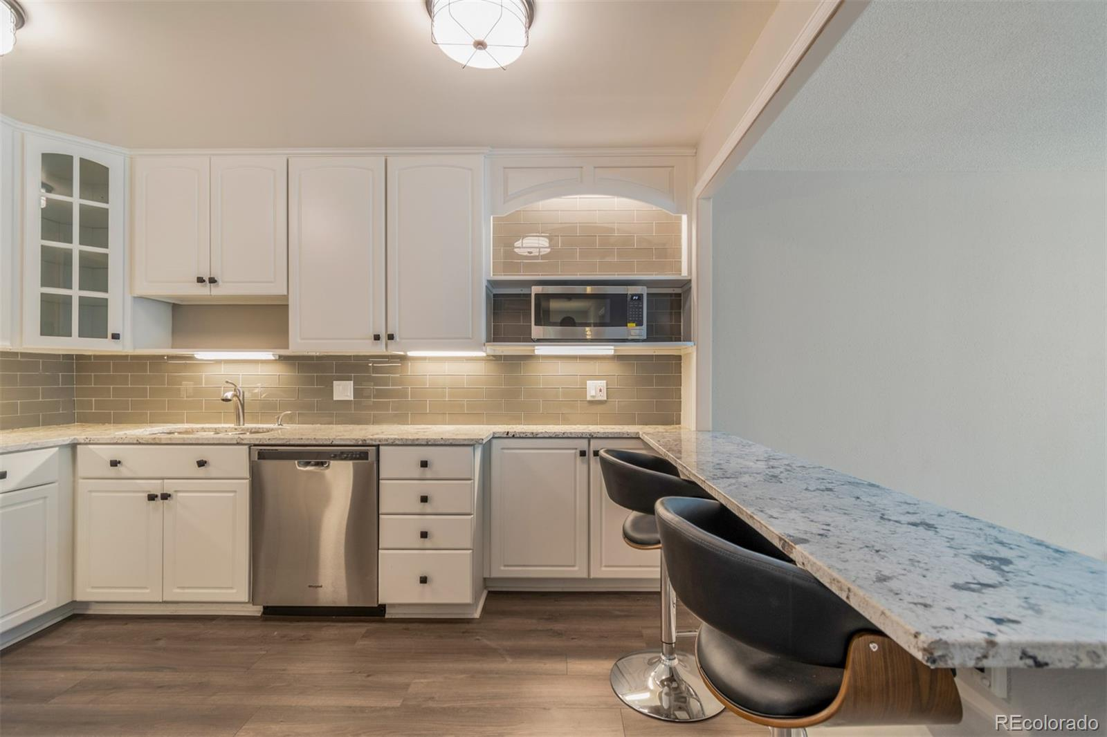 2 GARAGES are included with this unit . FORMAL DINING ROOM . Fabulous remodel with high end finishes.  New kitchen and baths, all new appliances, formal dining area plus counter bar. Designer touches throughout.  Be the first to see this great unit.  Sits back off the street so very quiet location.  Seller is motivated and may consider trade. Garage 182 in lot 9  and other garage is across street in lot 8 and is #55.