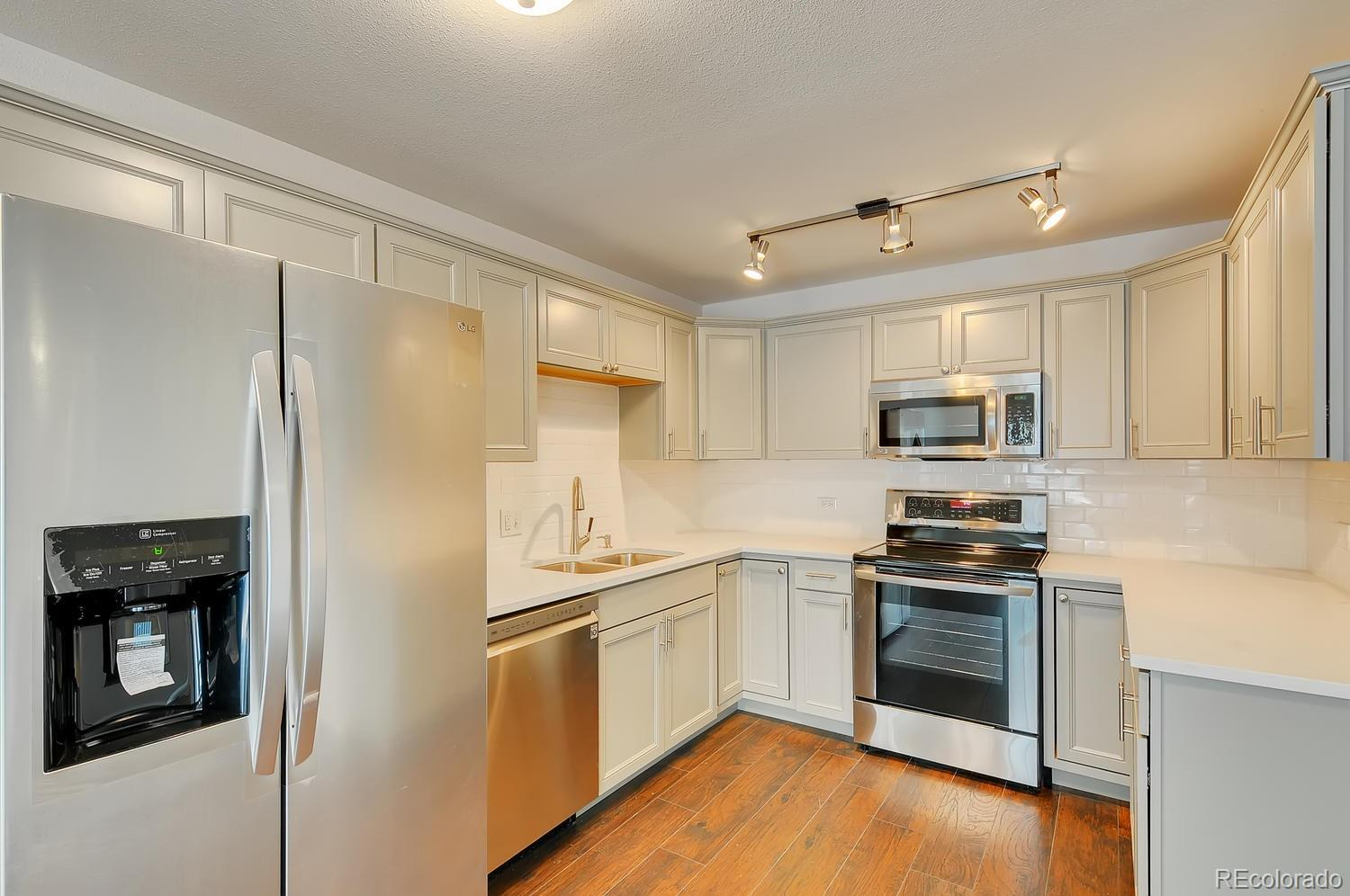 This one has it all! Ground floor unit and totally remodeled. Walk out from your Lanai into the green space. This building is tucked back off the road for ultimate serenity. The kitchen and bathrooms are all new as well as the flooring and paint! Nothing to do but move in. This price beats any of the 2 bed 2 bath in Windsor Gardens with this level of updating. Easy walk to the community center and golf course. Colorado's premier 55+ active adult community provides 24-hour community security, clubhouse with indoor & outdoor pools, hot tub, sauna, activities, clubs, Golf course & restaurant open to the public. Monthly HOA dues include annual property taxes, water, sewer, heat & trash. Centrally located to everything. FHA & VA approved! Short walk to Highline Canal and Windsor Lake.