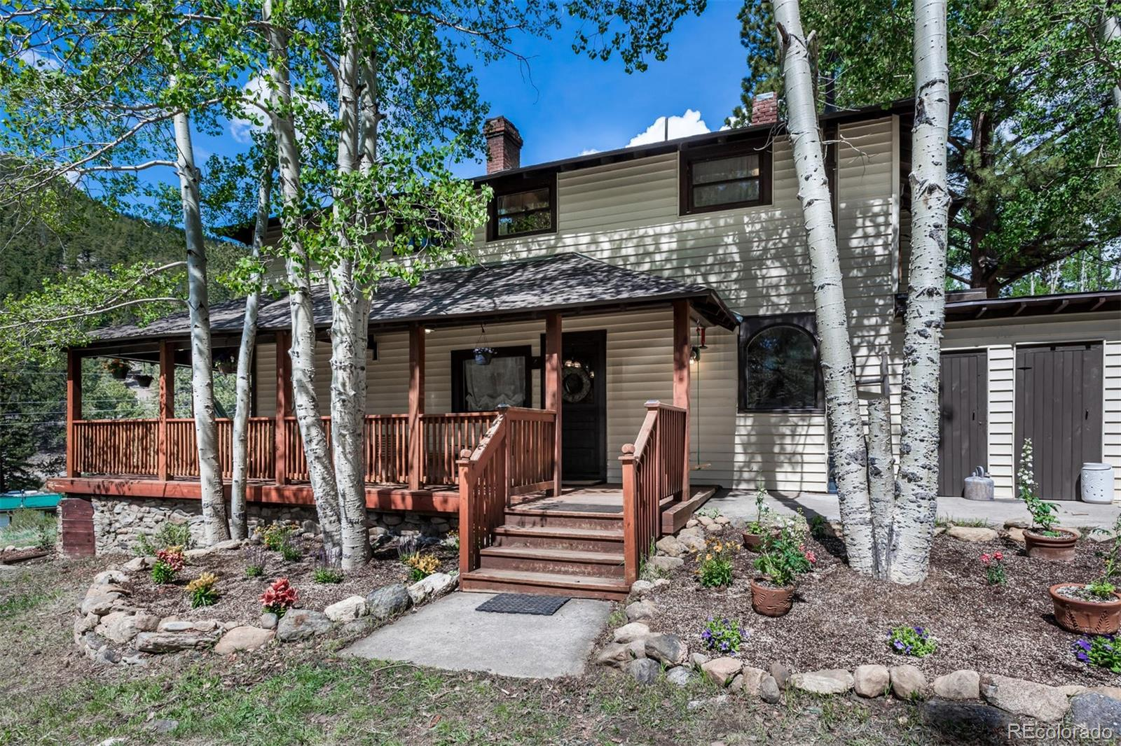 Make Memories* Looking for your dream home.. something different*This charming 4 bedroom/2 bath mountain home living the dream!  Built at the turn of the century with many updates newer roof and 4 bdrm septic system * experience blending the country simplicity of days gone by with all the convenience of today's amenities. Unbelievable wrap around deck * soak in the sunshine, fresh air, and pristine  snow capped mountain views on your expansive covered romantic  porch. Seasonal creek and small pond on the property * cottage shed or playhouse*. Easily fish the North Fork of the South Platte River via the community area in Bellford Mountain Heights* no fees *See supplements for special glimpse of history * New wood flooring on main level*new woodstove and 